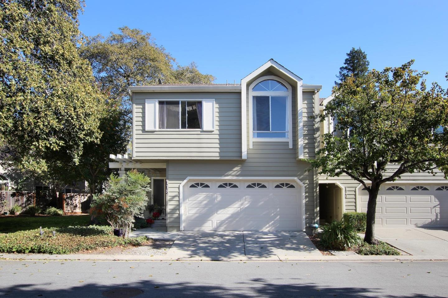 Nestled in a lovely Santa Cruz neighborhood, in the highly desirable Brookside Glen community is this peaceful 3 bedroom 2.5 bath townhouse. This development sits alongside the Branciforte Creek, surrounded by manicured greenery, tall redwoods, a conveniently close to walking paths that connect you to all main city streets for a perfect blend of city and suburban living. Only one adjacent unit with lush grass, trees, and additional parking on the other side.  This two-level home has custom upgrades throughout, gorgeous wooden floors, a large spacious master bedroom with his and her sinks, modern shower with built-in bench and floating rain shower head, high vaulted ceilings, large U-shape kitchen with plenty of counter-space and modern appliances, and an open floor plan with easy access to back patio. This property and community have the essential luxuries, with a low-maintenance homeowner lifestyle close to the beach, Downtown, and the commute routes.