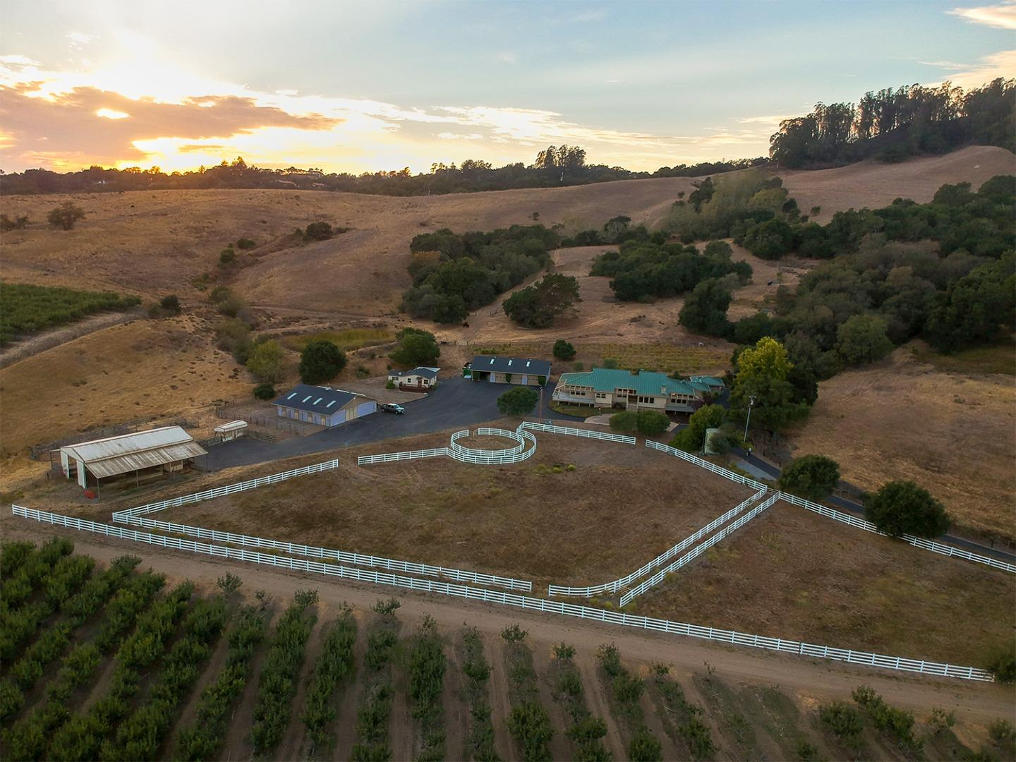 Welcome to the Dietrich Ranch.  Privately nestled in the foothills of the Santa Cruz Mountains, this secluded 191-acre private retreat awaits its new owner.  The preserve-like setting features a 31.6-acre apple orchard, equestrian facilities, small vineyard and plenty of open rangeland.  A private gated entrance and long driveway leads to the 3,940 sq. ft. custom home, which is tastefully appointed w/ a large kitchen, open floor plan w/ soaring ceilings, private office, 3 bedrooms, 3 ½ baths & two large outdoor porches, which will be enjoyed in this warm micro-climate.  A large 2,560 sq. ft. garage w/ 4 roll up doors offers abundant storage for your car collection or other hobby. A separate 1 bed, 1 bath guest house, horse barn w/ stables & hay barn round out the improvements.  This unique property, all within close proximity to Silicon Valley, Santa Cruz and the Monterey Peninsula, offers the rare chance to escape our busy schedules and recharge in solitude or with friends and family.