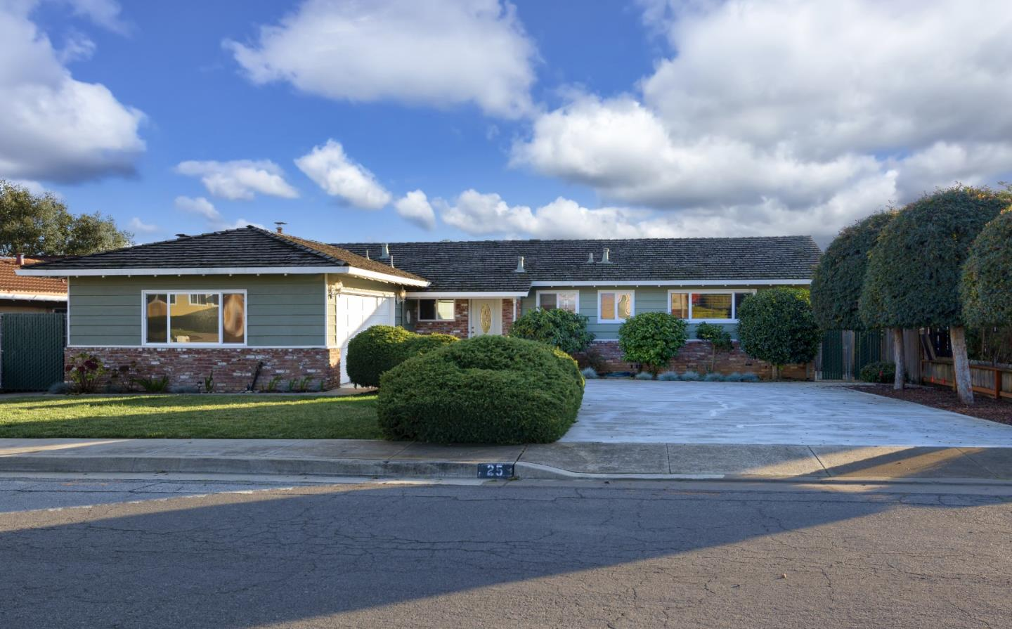 Enjoy the views of the hills in this quiet and well-established neighborhood that is nestled between Corralitos and Watsonville. This community, with its wide roads and sidewalks, is the perfect setting to raise a family, or just to enjoy peace and quiet. It's a solid move-in ready, well built home, with 3 bedrooms, 2 bathrooms. South facing in the back keeps this home bright and warm. Double pane windows throughout. The wood burning stove in the brick fireplace with gas starter is perfect for cozy nights. The french doors from the living room lead to the large backyard with two apple trees, a built in bbq w/sink, & a covered patio. It's a perfect setting for entertaining. It has a double car garage and lots of parking on the driveway for guests. Underground utilities! Great schools for the kids (Bradley Elem, Aptos JH and Aptos HS). Homes in this neighborhood rarely become available for sale.  Take advantage of this great opportunity and make this your home for generations to come!