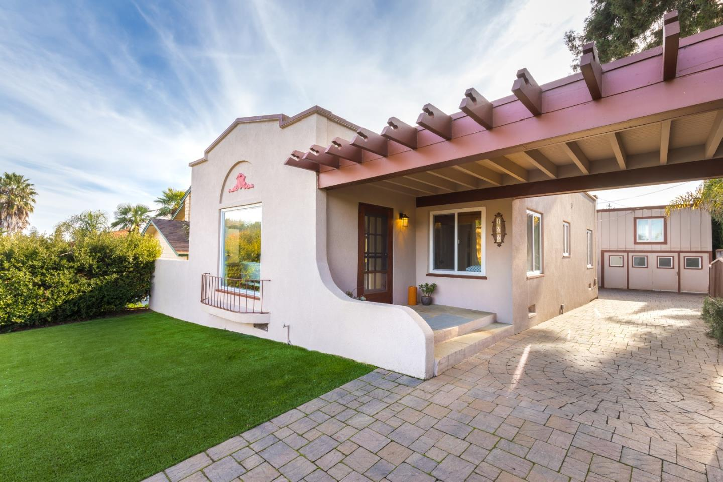 This classy Spanish-style Bungalow was moved up the hill from Ocean St to a more suitably distinguished neighborhood in the 30s. She's clearly at ease here, and you will be too! She enjoys expansive views of our city's lights & the distant Monterey Bay, sunny & tidy grounds, fruit trees, garden beds, long-time neighbors and gated privacy. A detached 1.5 car garage and nimble (but not rentable) 2nd story studio-space provide harmonious companionship. Because of her proximity to town, and to the innovative campuses over the Hill, she doesn't feel isolated or distant. Over the years, her inhabitants have reverentially tended & preserved her beautiful wood floors, coved ceilings, picture rails and classic moldings. And their lavish embellishments and newfangled fixtures (like appliances, cabinets, counters, wiring, fireplace, furnace, foundation bolts, roofing, windows and more) will be her lease on many graceful and happy decades to come. You should meet her! Let me set that up : )