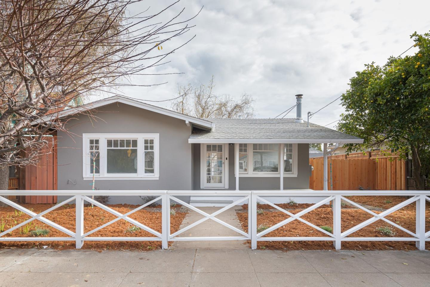 Fully remodeled 1928 Craftsman Style California Bungalow in desirable Seabright neighborhood close to the coast.This 2bedroom 1 BA single level home has a detached finished garage, newly refinished hardwood floors and fresh paint. The updated kitchen and bathroom pair modern materials with vintage styling to compliment the homes original design. Classic Bungalow front room includes wood stove surrounded with built in cabinets leading into a bright kitchen and dining room; which opens onto the large deck and the sunny backyard. Outside the house is surrounded with all new landscaping, fencing and decking. Established trees combined with new plantings, new ground cover and new foot paths in the back yard are just waiting for your personal touches. With room for a hot tub and more. Perfectly finished with exposed wood rafters and vintage light fixture, you just need to add a glider and a pitcher of lemonade. . . this turnkey beach bungalow is perfect for anyone.
