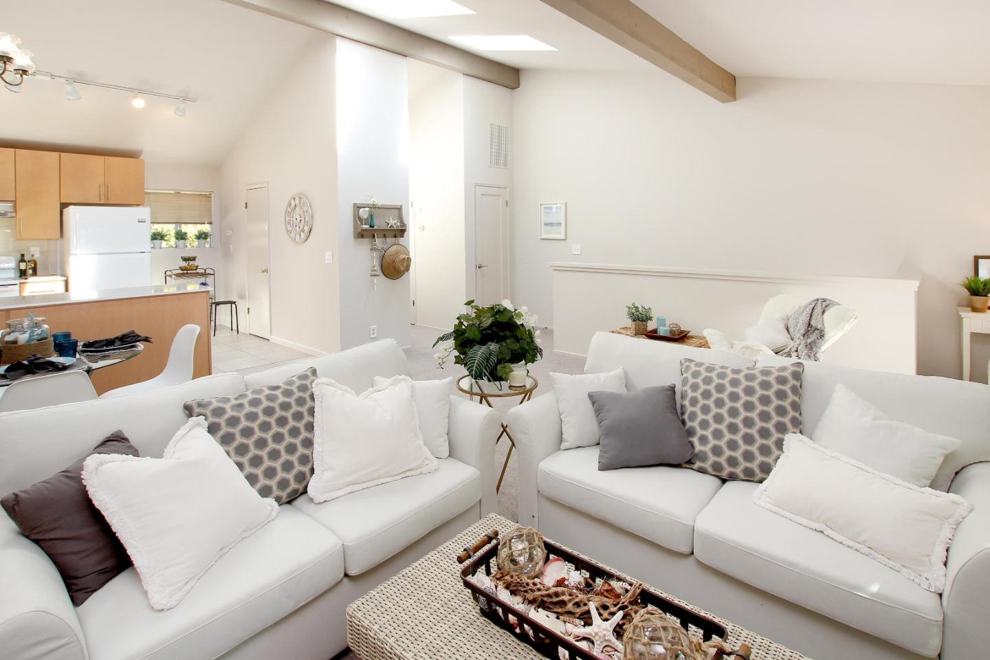 Serene townhouse sitting on the rodeo gulch greenbelt. Centrally located and walking/biking distance to Capitola's beaches, shopping, and dining... close to everything, this location can't be beat! The reverse floor plan with vaulted ceilings and skylights in the living room allows an abundance of natural light. Set far off 30th avenue privacy abounds in a treehouse like setting, you would never know you're in the middle of town. Fresh paint, updated kitchen and bath with quartz countertops. This house is ready for you to call your own!