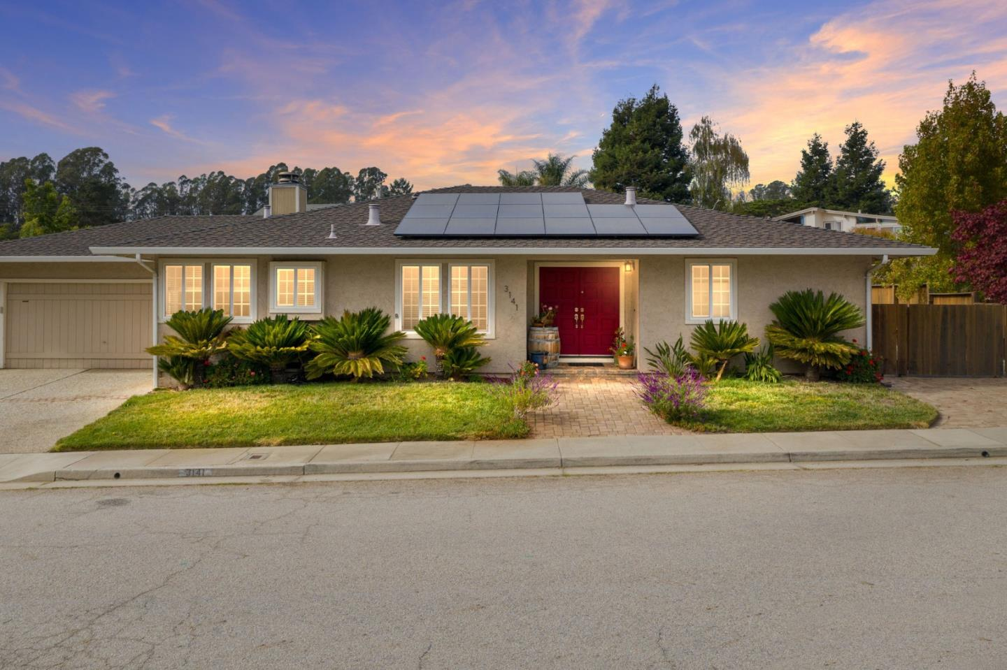 Both beautiful & modern, this single-level 3BR/2BA home is located on a corner lot in a lovely Soquel neighborhood - less than a mile to the beach. The interior of the the home features a sunken living room with a wood beamed ceiling and fuel burning stone-faced fireplace. Newly installed vinyl plank flooring in the kitchen, dining room & entry plus radiant heated marble tile in the bathrooms. In addition to being well insulated and having upgraded vinyl windows, the home features an efficient forced air gas furnace which results in low natural gas bills in the winter, and an owned solar panel system which means low electricity bills. This property also has an attached two car garage, sunny & fenced back yard w/ a custom arbor, and a large paved side yard big enough to park an RV/boat plus a sewer inlet, hot/cold water supply, and an electrical hook up. Walking distance to Maplethorpe Park and New Brighton State Beach, just minutes to great schools, shopping, dining and freeway access.