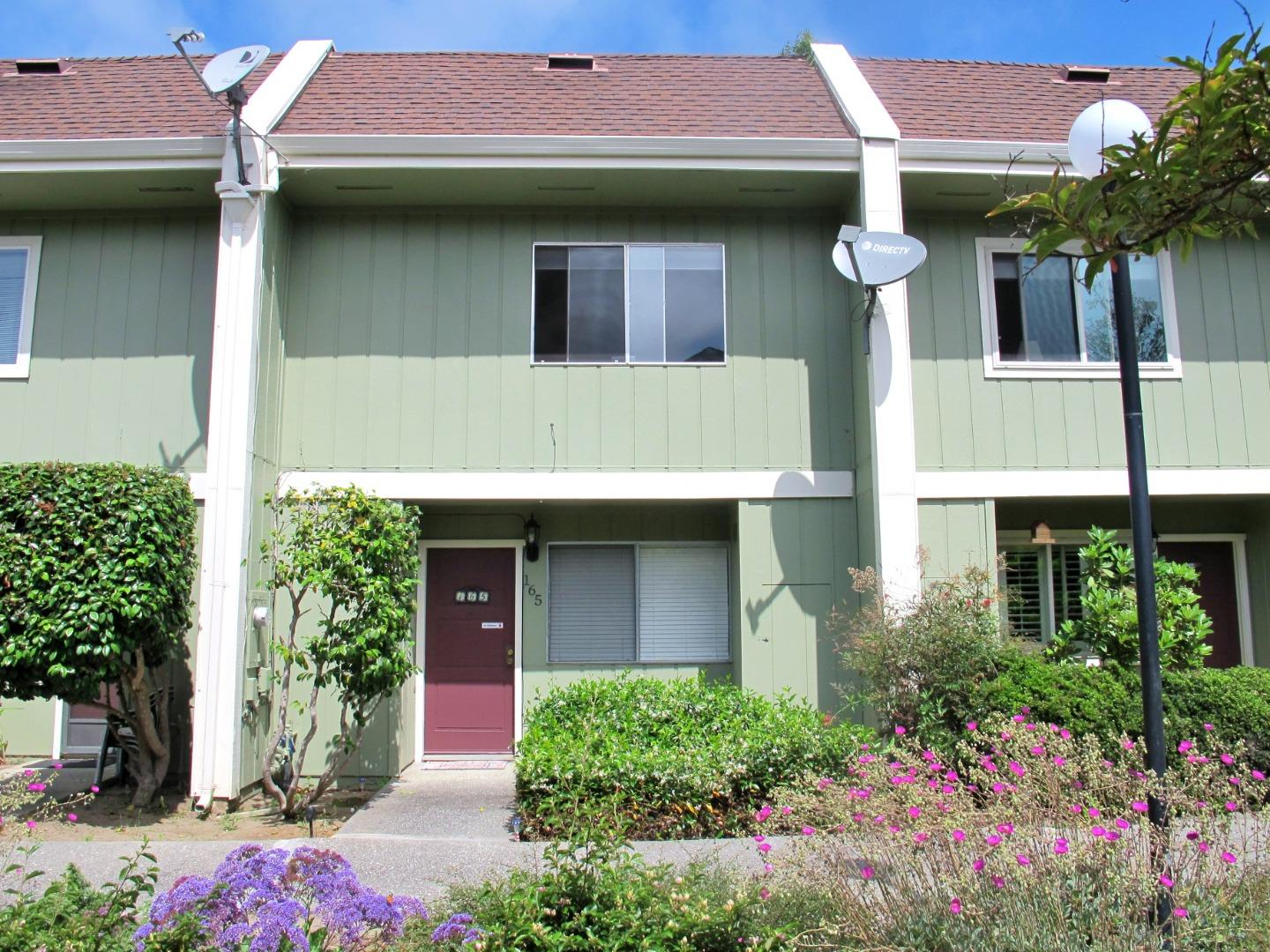 This back of the complex townhouse has 2-BR, 1.5-BA. Enter from the 2 assigned Carports or front door on the ground floor you will have a LR with wood laminate flooring that flows to a tiled kitchen/dining area, overlooking a private back patio. The kitchen has tile counters, wood cabinets, stove, and pantry with the laundry. A 1/2 bathroom is also on the 1st floor. A staircase w/wrought iron railing leads upstairs, where two carpeted BR & full bath are located. Spacious master BR has 2 closets, w/accordion doors & plenty of room for a separate sitting area. The main bath has a tiled floor, a separate vanity/sink area with extra storage space for linens, as well as a shower/tub combination & additional sink. The complex includes walking paths & a heated pool. A lush community garden & playground are nearby, walk or bike ride from the harbor or many other attractions, including beachside restaurants & coffee shops. During the blackouts in the area, townhouse did not lose power.