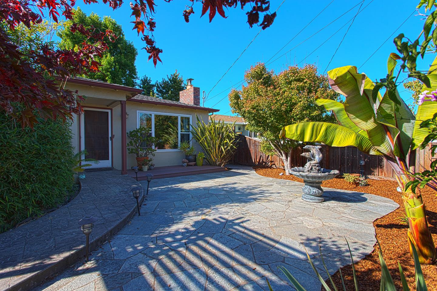 This adorable, single-level bungalow sits on a private street just minutes to the beaches, ocean, yacht harbor & amazing culture that Santa Cruz has to offer.  Situated on a massive 7500+ sq.ft. professionally manicured lot, with paved patios, private decks, outside Tiki Cabana/Studio/Workshop overlooking a beautiful, outdoor fireplace, this property is truly special offering privacy, space and nature.   Features also include gleaming hardwood floors throughout, a completely remodeled kitchen with granite countertops, top of the line appliances, spacious, open floor-plan, & radiant heat is also installed for your comfort in the remodeled, luxurious bathroom.   Upgraded plumbing & electrical.  Truly a beautiful home on a huge, private, beautiful lot in one of the best, coveted, central locations of Santa Cruz.