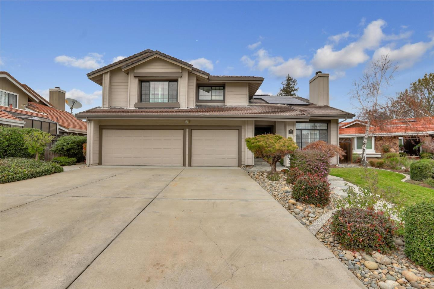 This gorgeous turn-key home sits on a cul-de-sac, offers an open floor plan, soaring ceilings, and comfortable natural lighting.  Ideal for family and entertaining, there is a formal living, dining, separate family room, gourmet kitchen with breakfast bar, kitchen nook with atrium windows, stainless steel appliances, double ovens and trash compactor.  Updated with attention to detail incorporating smart/WiFi lighting, recessed lights, plantation shutters, security system with cameras, pelican water filter, newer appliances, and surround sound speakers in the family room. On the main level, a full bathroom and bedroom and on the second floor, a spacious master suite retreat with fireplace, walk-in closet with organizers, jetted tub, and double sinks. Professionally landscaped, the front and back yards are low maintenance and solar paneling keep electric bills low.  Additional amenities include a heated pool, hot tub, attached 3-car-garage, extra storage sheds, and top-rated schools!