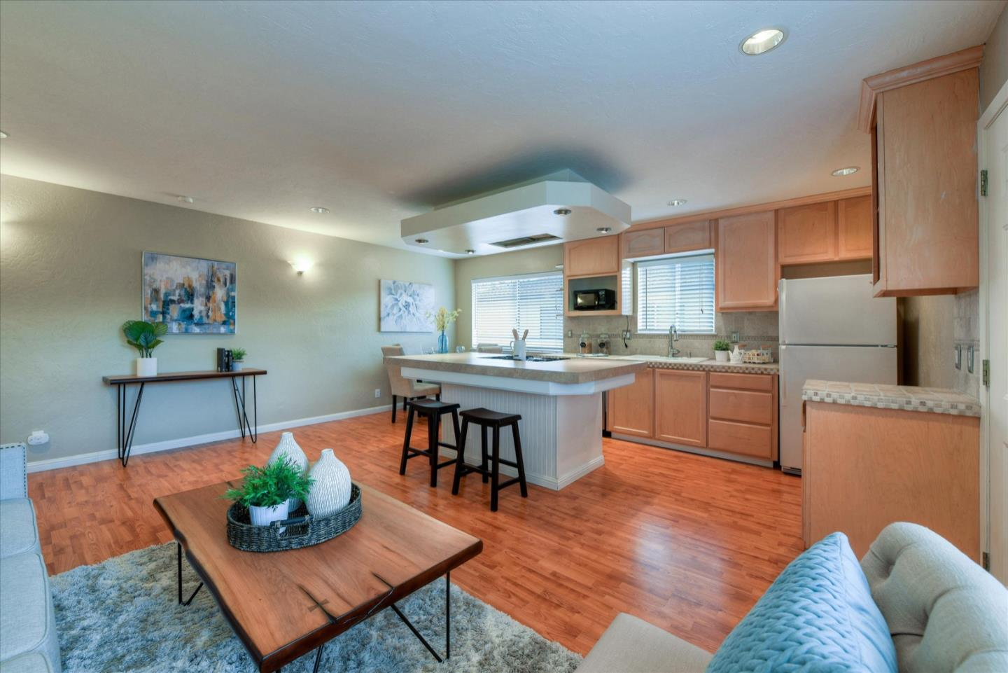 Just a few blocks from downtown Campbell. Upstairs unit w/lots of sunlight & private balcony. Laminate flooring; recessed lighting, kitchen w/island & breakfast bar; bath w/jetted tub & pedestal sink; A/C; shared carport w/storage; shared laundry; community pool/clubhouse. Proximity to 17/880 & 280, downtown Campbell, Pruneyard, ValleyFair/Santana & new Google Campus. Campbell Elementary School: Campbell School of Innovation (CSI) K-8 & Campbell Union High School: Del Mar High.  HOA Dues: $353/month