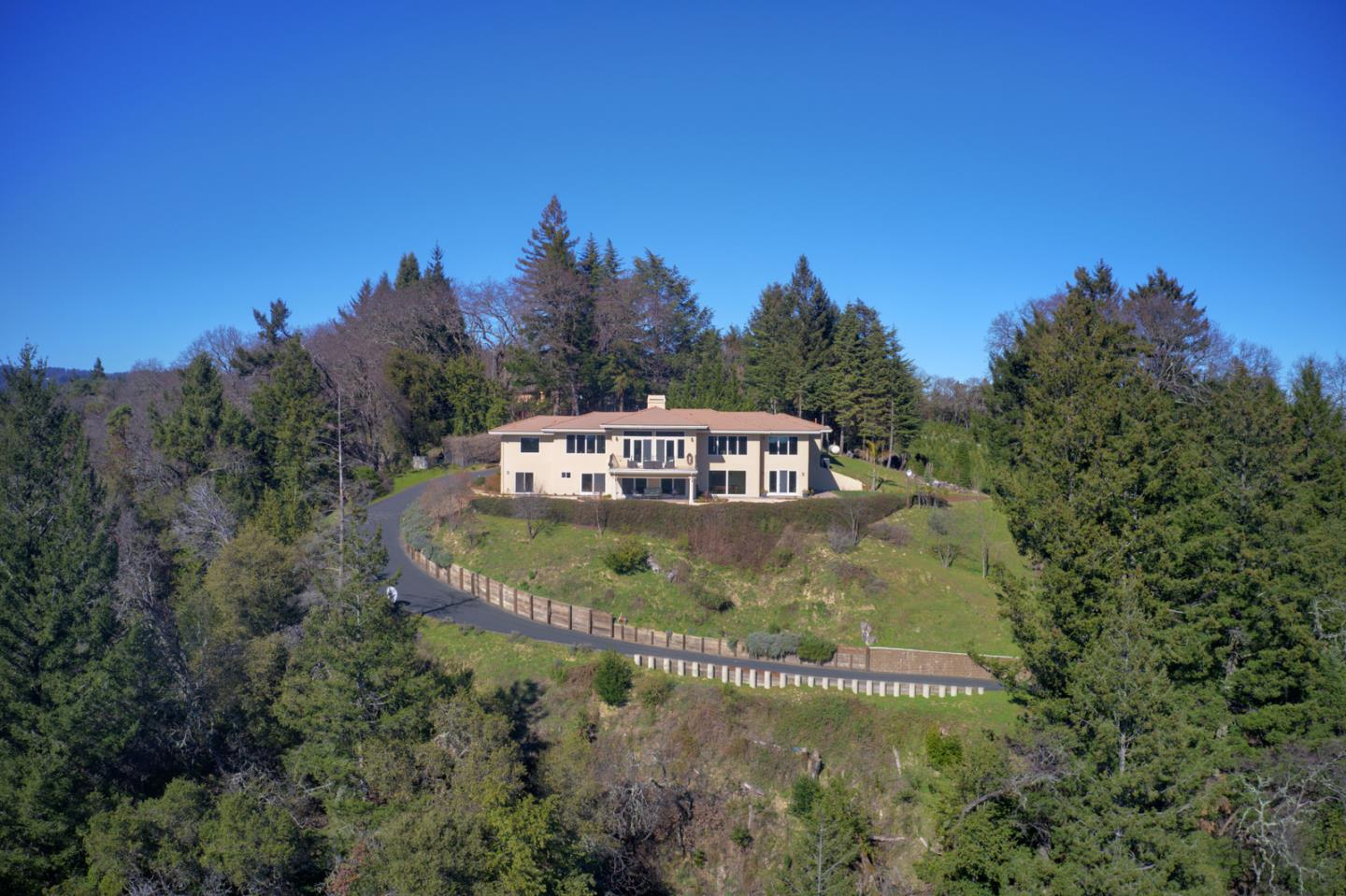 Once you experience everything this incredible estate has to offer, you will never want to leave! This stunning, luxury estate is nestled on one of the largest private parcels of the Santa Cruz Mountains. Your very own, majestic 86 acres to discover yet just minutes to downtown Los Gatos. Step into the grand entry with high ceilings & an abundance of natural light as you enjoy breathtaking views all the way to Monterey from every room. Gleaming hardwood floors & new carpet guide you through 5 opulent bedrooms, 3 full baths & 2 half baths including a luxurious master suite with a fireplace, resort-like bathroom and spacious walk-in-closet. Builder spared no expense with high end finishes & exquisite attention to detail throughout. Seller is the original owner & has meticulously maintained the property. Beautifully landscaped grounds with plenty of areas to hike, play & explore with swings and your own personal zipline. This estate is not just a home, it's an active & peaceful lifestyle!