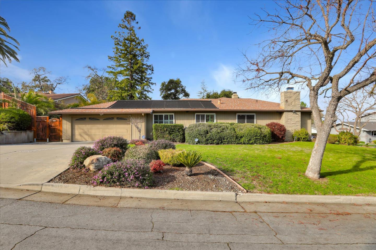 In the heart of the Almaden Country Club neighborhood lies your own private oasis! With 5 spacious bedrooms & 2.5 bathrooms, this tastefully updated home has 2,885 s.f. on a huge 12,700 s.f landscaped lot. Double doors open to a formal entry w/slate flooring. The functional floor plan Includes formal living, family, and dining rooms, a large eat-in kitchen, and separate laundry room. Three large sets of dual pane sliders lead to the peaceful & private back yard, complete with outdoor kitchen and sparkling Pebble Tec pool & spa (Both heated and salt water). Stained and stamped concrete, Connecticut Bluestone and natural rock waterfall blend seamlessly w/nature. Other notable features....Arched doorways, central alarm, granite counters, hardwood flooring, recessed lights, exposed beam ceilings, newer roof, and stainless appliances. Easy access to Silicon Valley companies and top schools...Williams Elementary, Bret Harte Middle, and Leland High. Come and see what you've been missing.