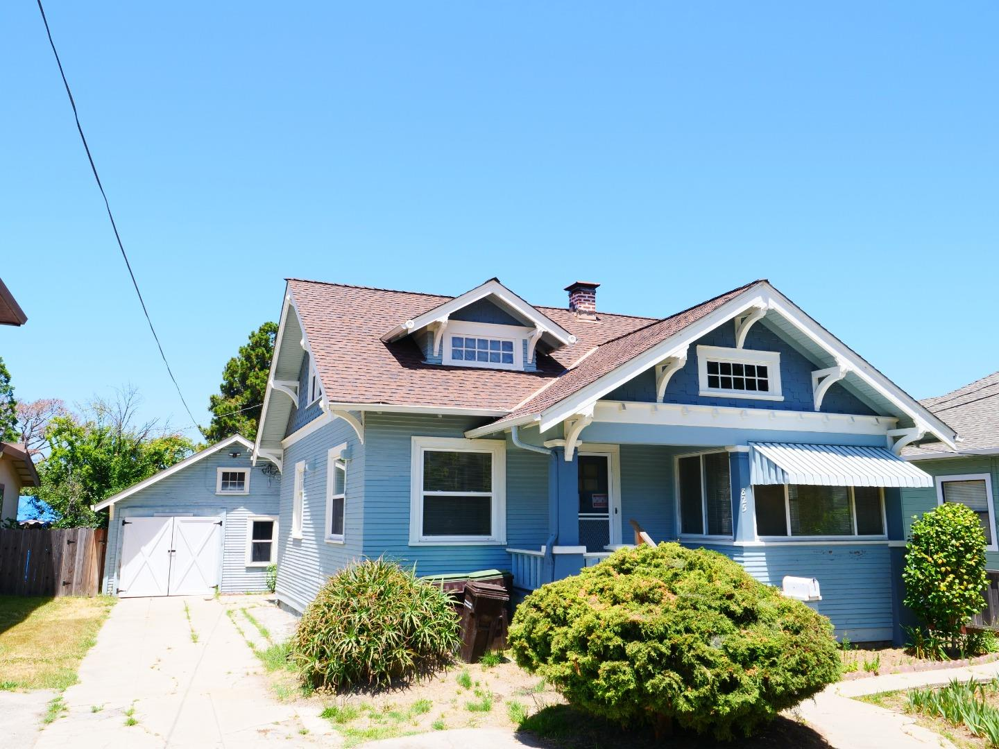 Home needs major updating, but classic architectural details throughout. Great location, walk to stores and restaurants. Large lot, detached garage and workshop ,combined 720 Sq ft., expansive  garden area, fruit trees.