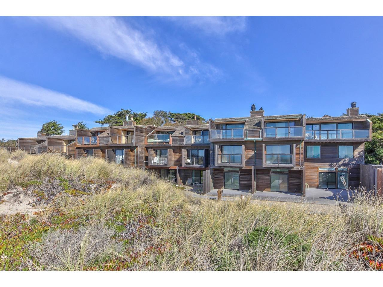 Beautiful Oceanfront Townhouse with Spectacular Views!  This spacious 3 story townhouse is in the coveted Pajaro Dunes Community and is just steps to the beach. There are 4 large bedrooms, each with their own full bathroom and private deck or patio. The main living area on the top floor features an open concept floor plan with a bright open kitchen, breakfast bar, dining area, large living room with a wood burning fireplace, wet bar, and a fantastic view deck to take in the 180 degree views of the entire Monterey Bay!  There are beautiful hardwood floors throughout, a stacked washer & dryer, and a private front patio for BBQ's and outdoor dining. Pajaro Dunes is a gated beachfront community along a gorgeous section of pristine coastline between Santa Cruz and Monterey, featuring tennis courts, walking trails, beautiful natural landscaping, and fantastic beaches! This wonderful vacation home is being sold fully furnished and ready to move right in and enjoy life at the beach!
