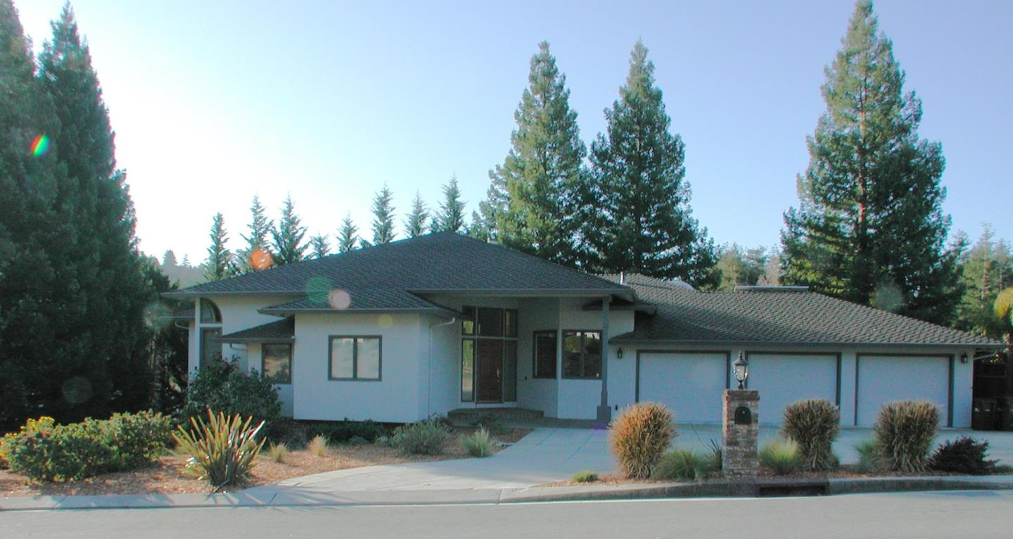 Beautiful home in Scotts Valley's premier luxury neighborhood---Granite Creek Estates---surrounded by thirty acres of open space.  Most ideal commute location:  10 minutes to Santa Cruz and 30 minutes over the hill to San Jose. Or it has a beautiful office in the house. Close to schools, shopping and restaurants.   This home has a wonderful division of space between upstairs and downstairs.  Fantastic entry, living room, dining room and family room kitchen along with the master and another bedroom/office on the main level and three bedrooms, bath and fabulous game room/bonus room/man cave with wet bar and wine cellar on lower level.  Lots of space outside and plenty of decks to enjoy the view.  An oversize three car garage, parking for a boat AND an RV behind the fence, solar electricity with battery backup, indoor laundry and a storage shed are all included.