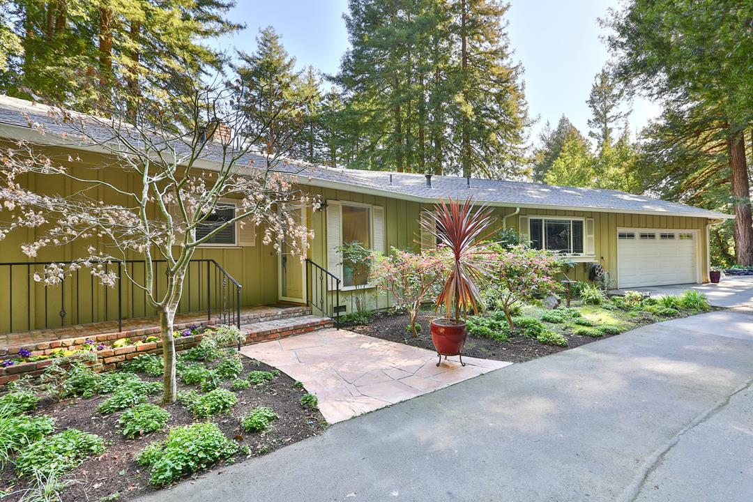 Marvel at this hidden gem in the Santa Cruz mountains, only 5min from Downtown! As the sun shines down through the majestic redwoods, you'll feel nothing but serenity. The elegant landscaping, redwoods, and patio highlight the 44,562 sqft lot. Step inside and you'll see beautiful wainscoting throughout the living area, skylights, and a grand fireplace. Mountain views throughout living area, master, and kitchen. Ample parking with an attached two car garage, covered carport (for oversized vehicles), and uncovered parking. Centrally located off Highway 9 you're only minutes from beaches, restaurants, shopping, hiking, and biking!