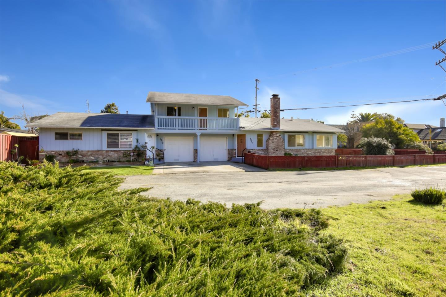 Back On Market! Desirable Pleasure Point / Live Oak / Capitola area duplex (2400+ sq. ft) situated on a large lot (12,500+ sq. ft) with beaches, surfing, parks, shopping, and dining all near-by. Only 3/4 mile to E. Cliff Drive and 41st Avenue. Unit at 1020 has 3 bedrooms (2 upstairs and one large downstairs) & 2 baths (1 downstairs) and has had recent updating. The darling Unit at 1022 has 2 bedrooms and 1 bath on a single level and is currently rented (tenants in this unit, do not disturb). Each unit has a single car garage with plenty of additional parking available. Both units include fenced yards. Each unit has separate gas  & electric meters. This property is truly a rare find and one that has so many options, possibilities, and opportunities.  This property has been in the same family for the past 38 years. Sewer Lateral inspections and repairs have been completed with County Approved Permit and paid by sellers. Buyers can view vacant unit while practicing social distancing.