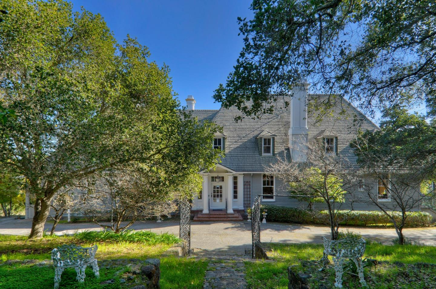 This cherished property is on the market for the first time in 60 years with roots dating back to 1910 on a rare lot of more than three-quarters of an acre. Spanning approximately 38,000 square feet tucked away at the end of a cul-de-sac, the private, park-like setting also features views out to the San Francisco Bay. This original Bakewell and Brown designed home boasts an impressive portico introduces the time-honored architecture with dormer windows on the steeply pitched roofline and a spacious terrace outlined with carved balustrades. Inside, the homes vast dimensions of almost 6,000 square feet exudes the homes original character that includes extensive millwork, hardwood floors, colorful wallcoverings, and vintage tiled bathrooms. Whether enjoying today or renovating for the future this treasured property is ready for the next generation. Convenient to Roy Cloud School (K-8) and midway between San Francisco and Silicon Valley, this is indeed a very special opportunity.