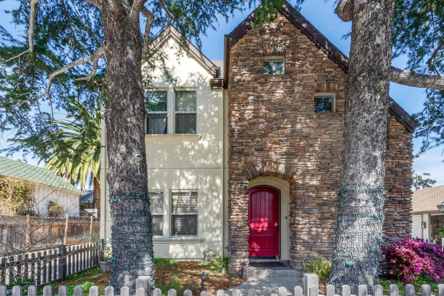 This cozy townhome has a unique stonework façade, with an arched entry. The door opens to a living room w/large windows, laminate floors, & recessed lights. A kitchen w/maple cabinets is open to the living area, w/its own recessed lights, a breakfast bar w/pendant lights illuminating the granite counter, & stainless steel appliances. Adjacent is a separate laundry room w/access to a one-car garage, as well as a half-bath. A carport adjacent to the garage offers additional protected space for parking. The unique stonework outside gives this home a one-of-a-kind & easily recognizable exterior. Inside, the more traditional layout features communal living spaces downstairs & bedrooms & baths upstairs. Upstairs are three bedrooms and two full baths. The vibrant neighborhood includes many amenities & local landmarks including Whole Foods, Shoppers Corner, The Buttery & restaurants. The location provides easy access to downtown Santa Cruz, local beaches, & commuter routes.