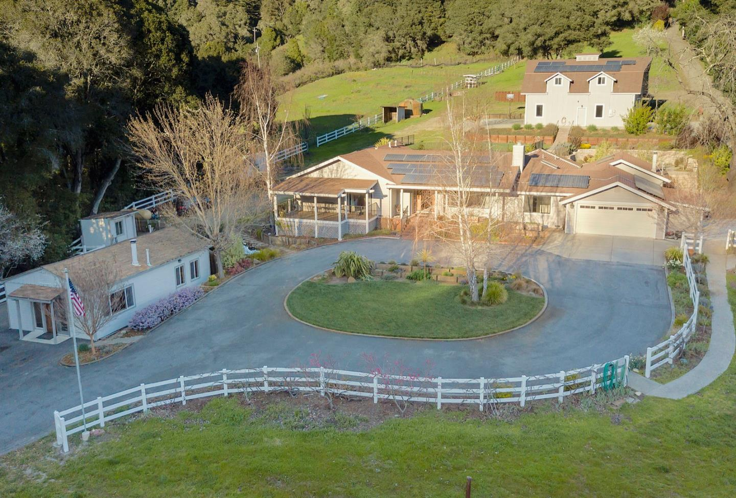 This ranch estate property is one of a kind among the sun soaked hills of Soquel.  More than 3 acres includes upper and lower pastures, gardens, more than 2 dozen fruit trees, an incredible 2-story finished barn and workshop, fish pond, mature landscaping, a gorgeous hard-scaped backyard that is perfect for entertaining, a separate 1 bedroom cottage/granny unit, a strong dedicated well, and plenty of sunshine for all your ranching and agriculture needs.  The spacious and well-maintained single level ranch home has separate family and living rooms, two fireplaces, a dining room with lots of natural light from the expansive wrap-around windows that look out to the backyard, an office/bonus room, large master suite with private deck and walk-in closets, solar panels (owned), automatic generator...and so much more.  Just 8 minutes to downtown Soquel and 15 minutes to Highway 17 at Summit Rd, a great commuting location as well.  This legacy property is a must see!