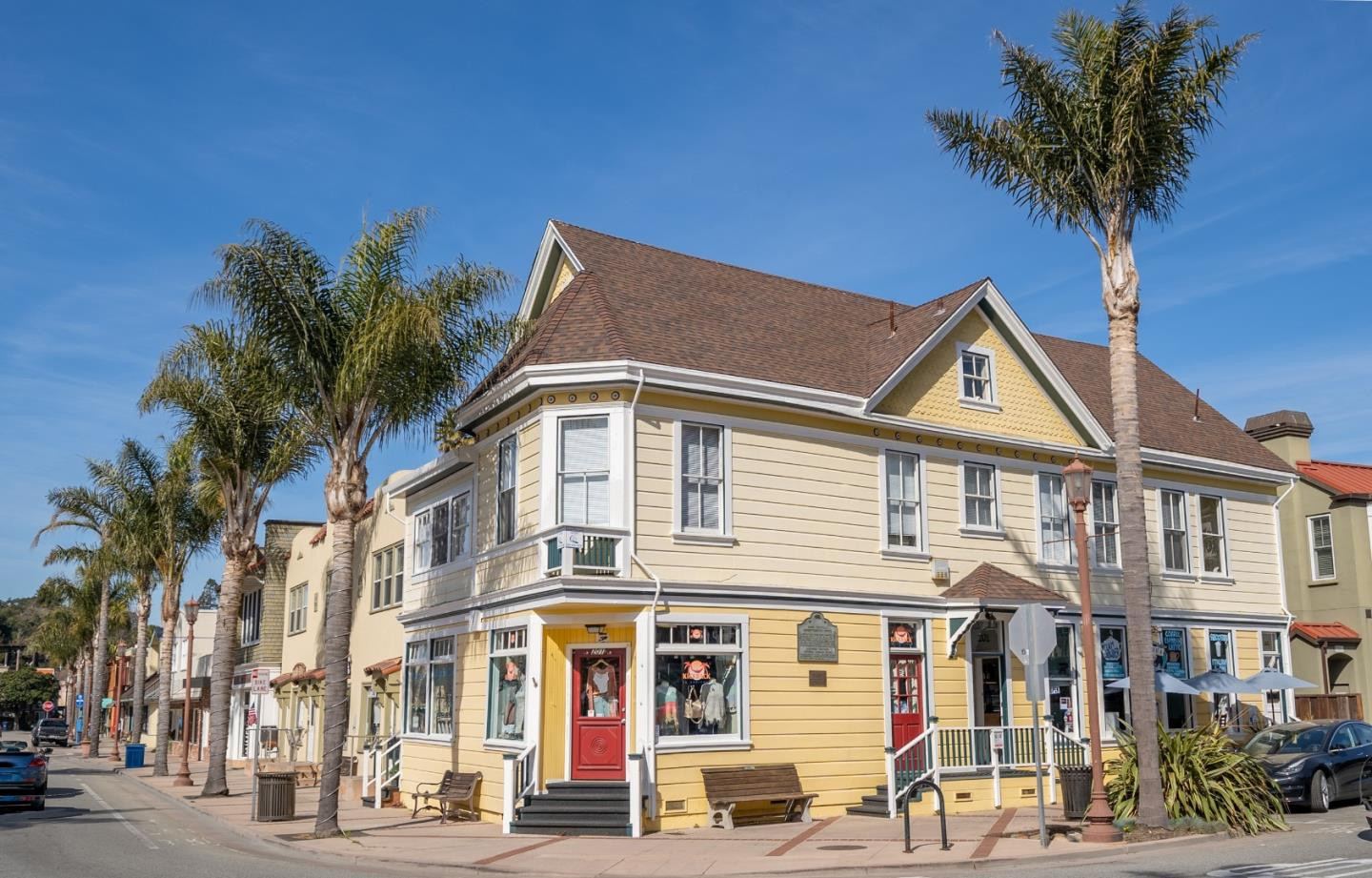 Opportunity to own a piece of Capitola history in a prime corner location in the heart of the quaint Capitola Village By the Sea. This trophy property once owned by F. A. Hihn served as the headquarters for Camp Capitola, California's first seaside resort community, until 1930. Restored in the 1970's and updated again in 2018, it has the prestigious designation as being marked a California Historic Landmark. The beautiful architecture & freshly painted exterior stands out and brings attention to 3 commercial spaces, currently 2 retail stores & a deli with 2 half baths. On the 2nd floor set above the street are 2 one-bedroom apartments recently renovated with new kitchens, baths, & flooring; one offers great ocean views. Set in the vacation rental zone offering flexibility for long or short term rentals. On the top level is a large attic space with high ceilings & half bath. Arguably one of the best locations in Santa Cruz County only steps to the beach.