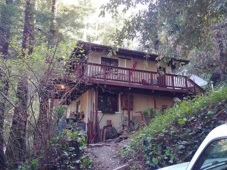 Come home to the redwoods near Loch Lomond.   Enjoy the clean air and views of redwood trees from the spacious decks.  Remodeled interior, 3 skylights.  Cathedral ceiling and an airtight wood stove in the living room.  Forced air heat as well.  Upstairs is  bedroom which leads onto a deck.  Down the other stairs is another bedroom which also has a separate entrance.  Laundry space is down there as well as 1/2 bath and office/storage room.  Custom cabinets in the kitchen and upgraded appliances.  Separate bonus studio/room, no bath, not included in square footage.  Owner prefers to sell the house furnished.