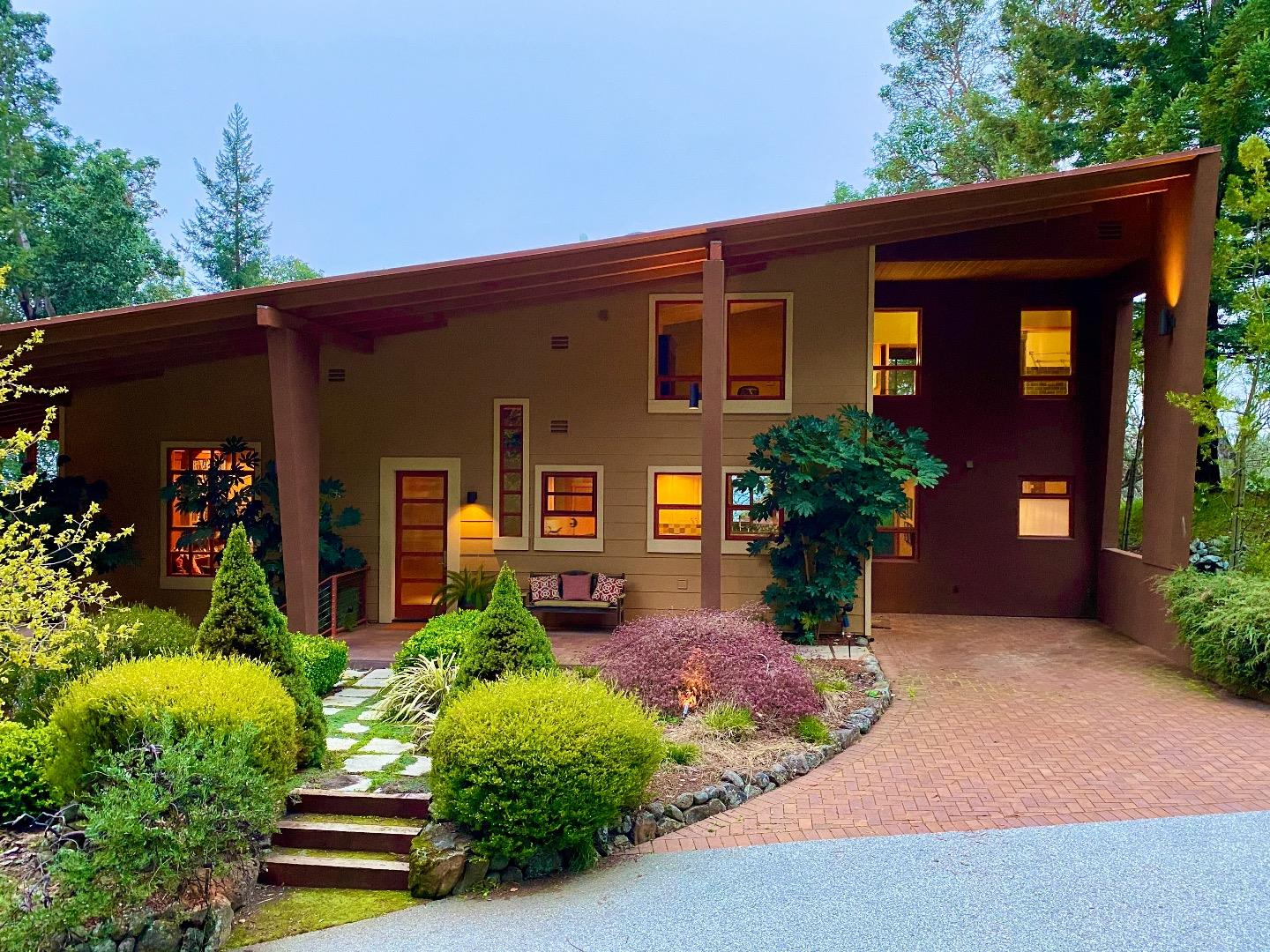 "Get out of the city but remain close in this luxury private light-filled ridgetop retreat on gated 48-acre parcel. Enjoy spectacular views over wooded canyons to the Monterey Bay and beyond. Relax in the open-plan, modern custom home designed in 2008 for artist couple. Unique in the Mountains. Two to four bedrooms with chefs kitchen overlooking patio and magnificent views. Premium tasteful finish throughout. Separate studio/guest suite with half bath. Hi-Speed internet Ideal for telecommuters who value privacy, natural beauty and quiet. South facing TPZ parcel with lots of usable land. Suitable for small vineyard, orchards. Strong, deep well with undiminished volume through dry years. 20 minutes from Los Gatos High School and stores. Or easy to home school without neighborhood distractions. Buyers must be comfortable with winding mountain roads. Owner willing to carry first mortgage. Click links to 3 different video tours. Families see our video about""distance leaning in the mountains"""