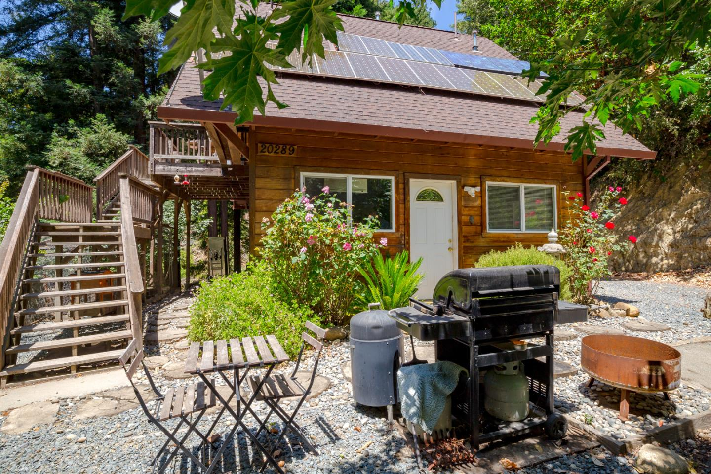 Escape to this Private, Off-Grid Retreat, a lovely and special find. Yes, OFF-GRID! No PG&E power outages EVER! A world away from the stress of city bustle, yet less than 15 minutes to downtown Los Gatos. Two-story main home with multiple outbuildings including a spa/tiny house getaway, large container workshop, storage buildings, storage containers and more. Residential compound or rental income potential. This well-loved property is anchored by magnificent old growth, watered by the creek, and powered by the sun. Hug a huge ancient redwood in a meditative spot by the creek. Plentiful parking with separation of space and room for large gatherings. Shared gated entry. Partially paved/dirt road. Paved driveway to the main house. Come see this Mountain beauty.