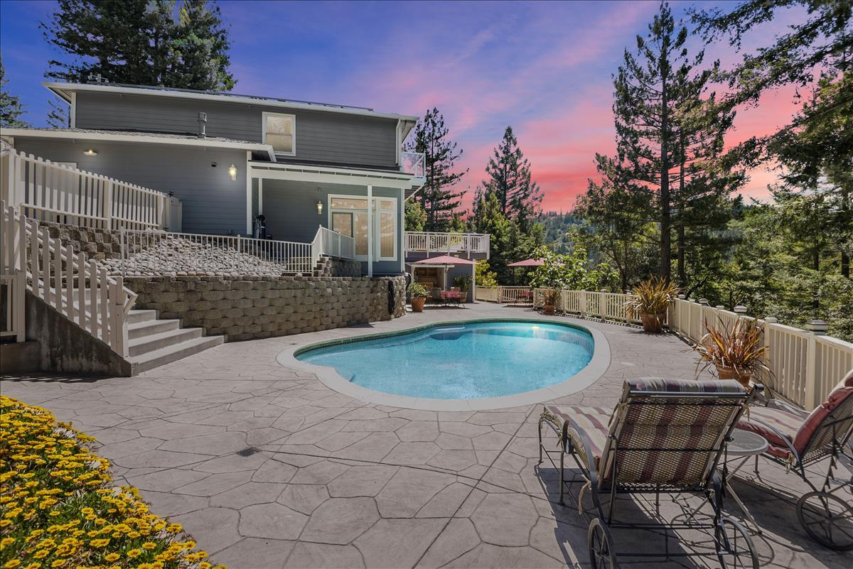 Feel the stress diminish when driving 3.2 miles from Hwy 17/Summit to your Executive Mountain Estate on 25+ acres. Complete privacy with stunning views, stream and private hiking trails just 20 min from downtown Los Gatos. Endless possibilities to build green houses. Access off Debbie Rd with potential to build a separate cottage for rental or family. This 4211 sq. ft home features 5 BR and 5 BA with a lower level featuring a private entrance, separate parking, bedroom, bathroom, kitchen and patio area. This area offers an office retreat or rentable separate living quarters. Natural light permeates throughout the home highlighting the vaulted ceilings and architectural designs. A chefs dream kitchen offers spacious room to cook and host all of your guests. For entertaining you will enjoy the private home theater, pool table room, 110-gallon built-in saltwater fish aquarium, pool/spa, outdoor bar, sports court and expansive decks to relax on. Top-rated LG schools! www.oldlogging.com