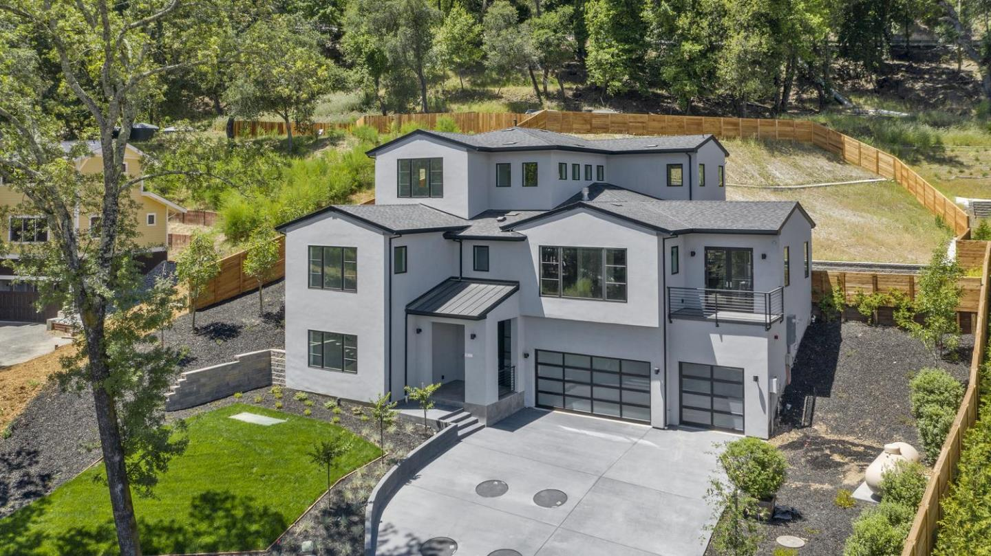 Rare opportunity to unquestionably own one of the best brand new contemporary estates in Los Gatos*This custom estate is over 4,600 SQFT with an enormous three car garage*This entertainers dream home was designed by Gary Kohlsaat and built by Massei Construction in 2020 and has 4 oversized bedrooms, 4.5 stunning interior designed bathrooms, and the huge downstairs bonus room could be a ground floor in-law suite*This estate includes an open epicurean kitchen and family room w/ top of the line Thermadore column series refrigerator, freezer, and wine storage*Enormous center island w/ quartz stone*European white oak hardwood floors, designer lighting fixtures, Jeld Wen windows, 5 foot linear fireplace, tall glass shower enclosures, walk in closets, custom cabinetry, & two laundry rooms*Just minutes to downtown, this estate is immersed in nature as it lies in the hills with captivating views*Los Gatos Distinguised Public Schools*Surrounded by other brand new $4M to $8M custom homes!!