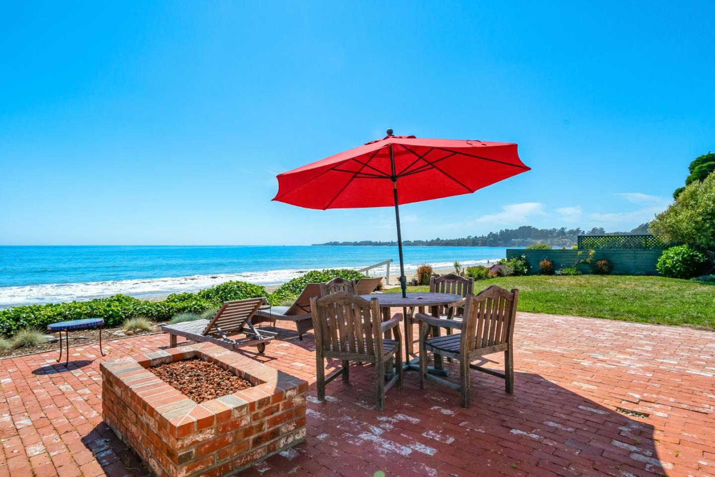 Beach front living for you and your guests, just a couple dozen steps from the sand and sea  in the gated Las Olas community. Relaxing on the brick patio with a book, or enjoying a sunset cocktail before a walk on the beach  all of these pleasures await you in this rare opportunity to live on the very edge of Monterey Bay, on the sand at Seacliff Beach.