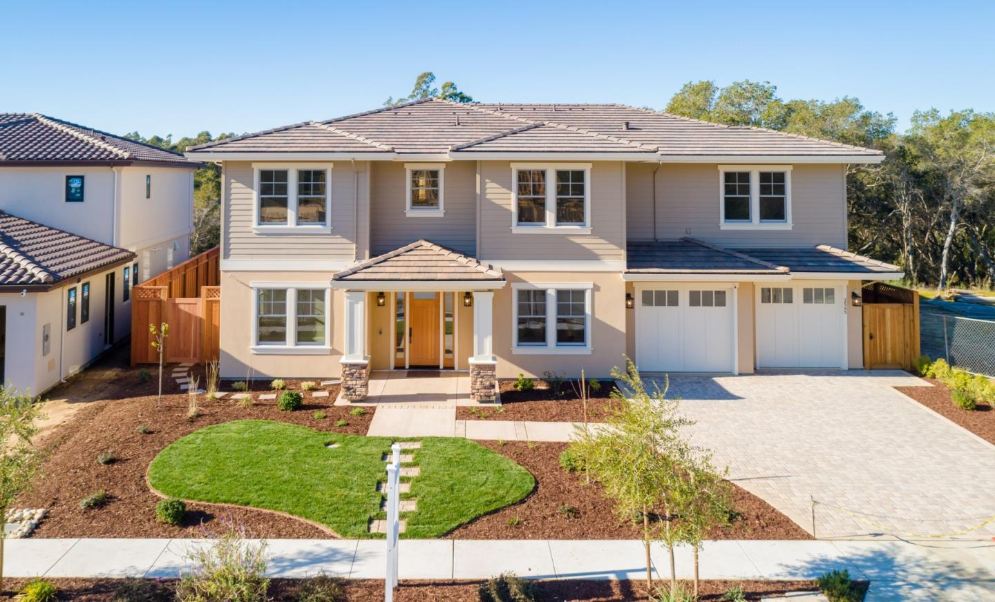 Welcome to the brand new luxury Benson Avenue Subdivision, located on a sunny secluded cul-de-sac adjacent to Santa Cruz gardens. Sweeping Monterey Bay ocean views, and green belt access await, along with miles of different hiking trails and serene landscape. This is a new, custom built home, with tasteful finishes and thoughtful amenities to match. Master suite has walk in closets and a luxury soaking tub. Enjoy radiant heat flooring throughout, custom closet systems, smart wiring, central vac system, surround sound, hardwood floors, quartz countertops, chefs kitchen, thermadore appliances and so much more! This home has a beautiful covered patio with accordion doors that look out to an unobstructed green belt. This is a great family home with easy access to an amazing school district, excellent commute location, downtown Santa Cruz shopping and restaurants, or just across the way beautiful Capitola and Pleasure Point beach neighborhoods. This stunning property is a must see!