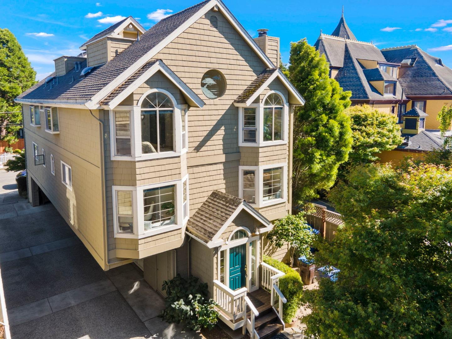 This 3-BR, 2.5-BA multilevel home is just a few blocks from the Santa Cruz Beach Boardwalk & wharf. The living spaces are on the main level, including a living room w/a cozy gas fireplace; a kitchen w/tile counters & white cabinets; a breakfast nook w/a bay window & window seat & a formal dining area with a wet bar tucked into an alcove. Carpeted stairs lead to three bedrooms: a master suite with hardwood floors, angled ceilings, a bay window and nautical porthole window to let in lots of natural light, and en suite bath with a separate tiled vanity area. The two other bedrooms are carpeted and have the same angled ceilings as the master bedroom, with custom windows and a shared bath with a walk-in shower. A rooftop deck is the perfect perch for starting or ending the day overlooking the ocean and enjoying the sunshine and sea breezes. With plenty of room for a family or guests, this home is close to many iconic Santa Cruz attractions for all ages, from rollercoasters to rolling surf.
