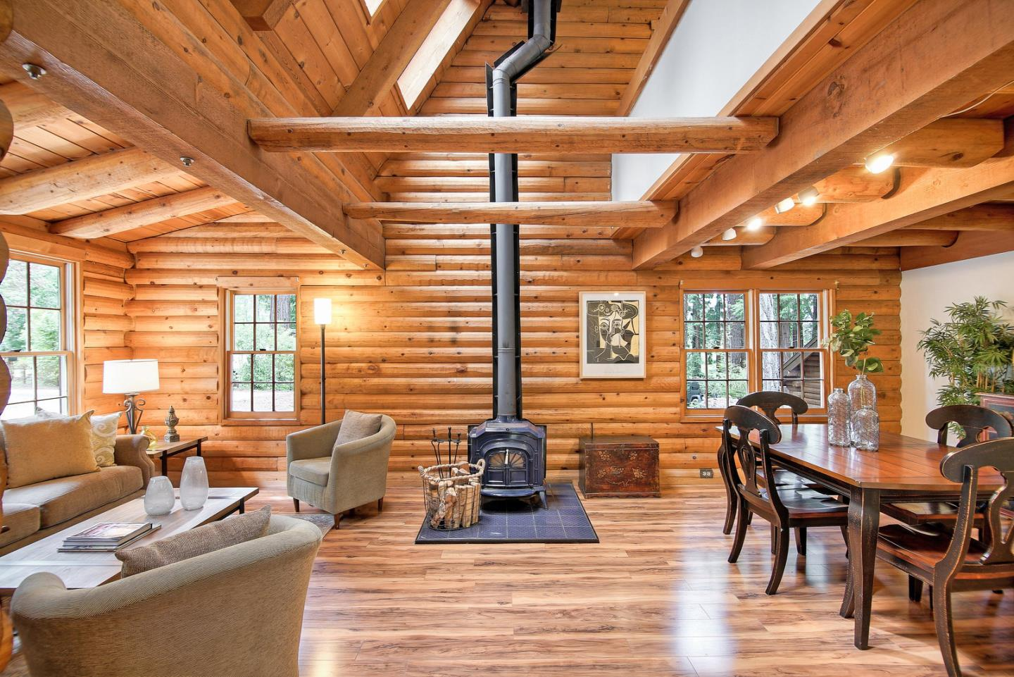 Set on a sunny knoll among the redwoods in a exceptional south Felton neighborhood, you'll love the abundance of charm and character at this authentic log home. The fantastic 2+ acre lot is fully usable with patios, decks, as well as plenty of space for gardening and outdoor activities. There is direct access to the TRAIL NETWORK that connects Henry Cowell State Park to Marshall Field and Wilder Ranch State Park. Hikers and mountain bikers LOVE this area! UCSC campus is less than 1.5 miles away when traveled by trail. Live like you're on vacation every day at this very special mountain retreat. Recent updates include new front deck, new rear deck, new paver patio, new flooring, new furnace, new kitchen counters, and new appliances. 2,124 sq ft of usable space that includes the detached 528 square foot studio with a 3rd bathroom, and 144 square foot heated sun-room. 6 miles to Santa Cruz, and 6.5 miles to Highway 17 in Scotts Valley. Excellent schools k-12.
