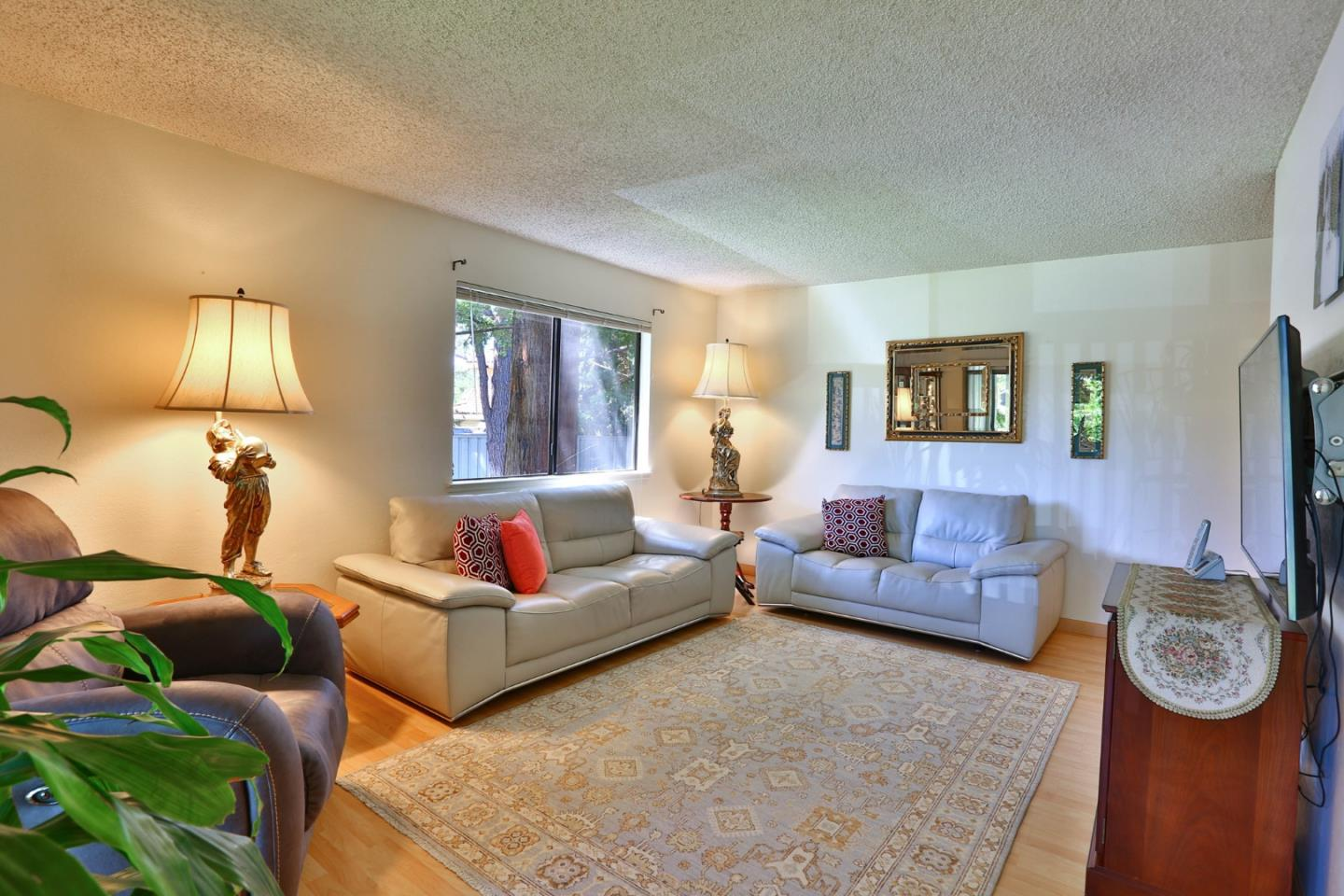 Serene oasis in the middle of Silicon Valley. Beautifully remodeled two bed/1 bath bright end unit with a detached 1 car garage. This first floor home features a balcony overlooking the mature trees, granite counter tops, remodeled bathroom and a huge master suite with a walk-in closet. The Oak Park community includes a pool, and an inviting club house. Excellent Mountain View and Los Altos schools: Bubb Elementary, Isaac Newton Graham Middle, and Los Altos High School. This home is perfectly located on the west side of Mountain View, near Castro Street, Whole Foods, San Antonio Shopping Center, Google and other high tech companies.