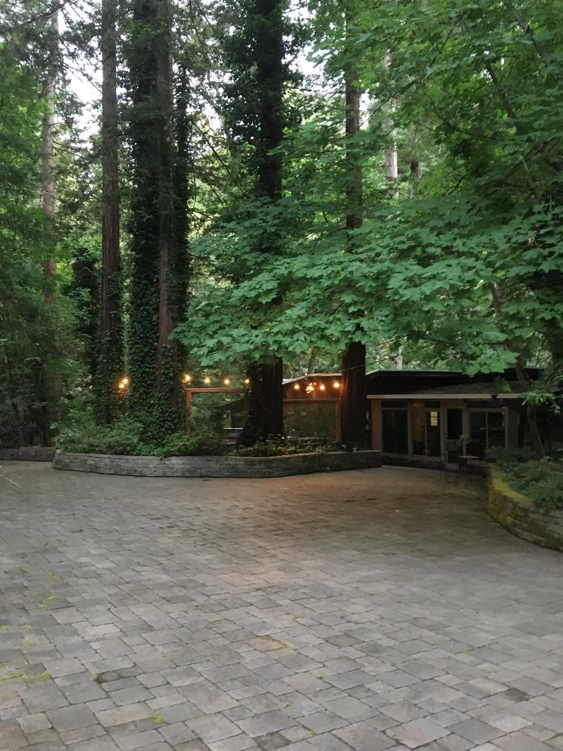 Location Location it's like being on vacation in the beautiful redwoods 24-7 two lots two parcel's first lot with home is .850 of an acre and the second lot with parcel number is .384  of an acre. approximate sq ff of home 1441. One bedroom 1 1/2 bath with a beautiful sun room so you can see all the beauty the tree's have to offer, seasonal creek around home, out side BBQ set up, beautiful decking around home .Now imagine coming home from work bottle of wine soaking in your hot tub.