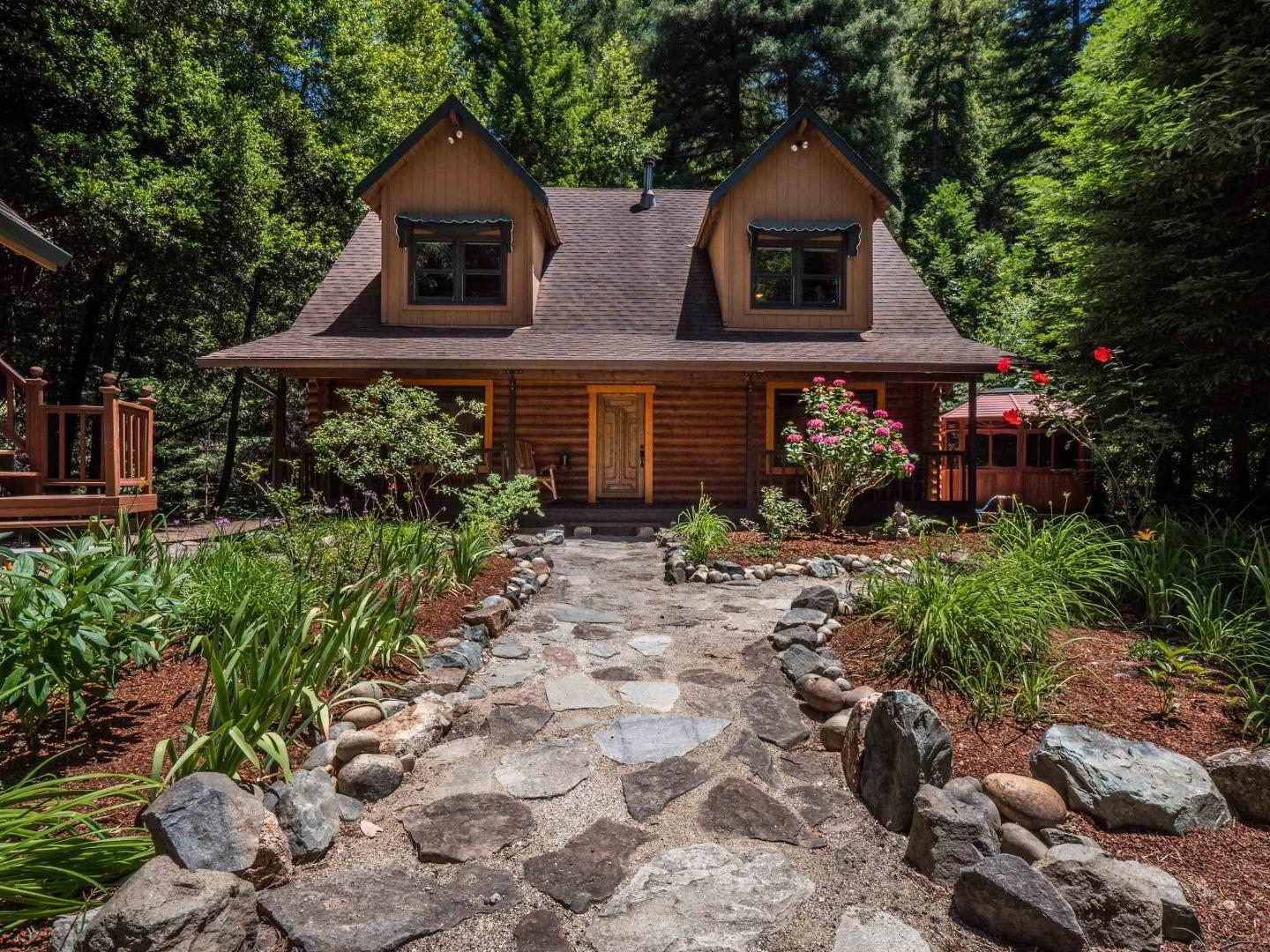 Inspired by nature, this upscale Log Cabin home is energy efficient while it retains the rustic feeling of a mountain cabin.  It is like being on vacation all year long.  The lot is 1+acre, there is a creek and  some beautiful Redwoods and you can spot an occasional deer or some wild turkeys passing by. There are great outdoor spaces; a huge back deck, covered front porch and a gazebo with spa. The kitchen has top-of-line appliances, solid oak cabinets and granite counters. There are custom wood frame dual pane windows throughout. Beautiful wide plank hardwood floors downstairs and plush New Zealand wool carpets  upstairs bedrooms. Master bedroom is on the first level and has a tiled bath with large stall shower. Upstairs bedrooms are huge with large walk-in closets. The quaint upstairs bathroom has  bead board wainscoting, pull chain toilet and claw foot tub. Large single car detached garage has an upstairs bonus room and there is additional carport and lots of parking.