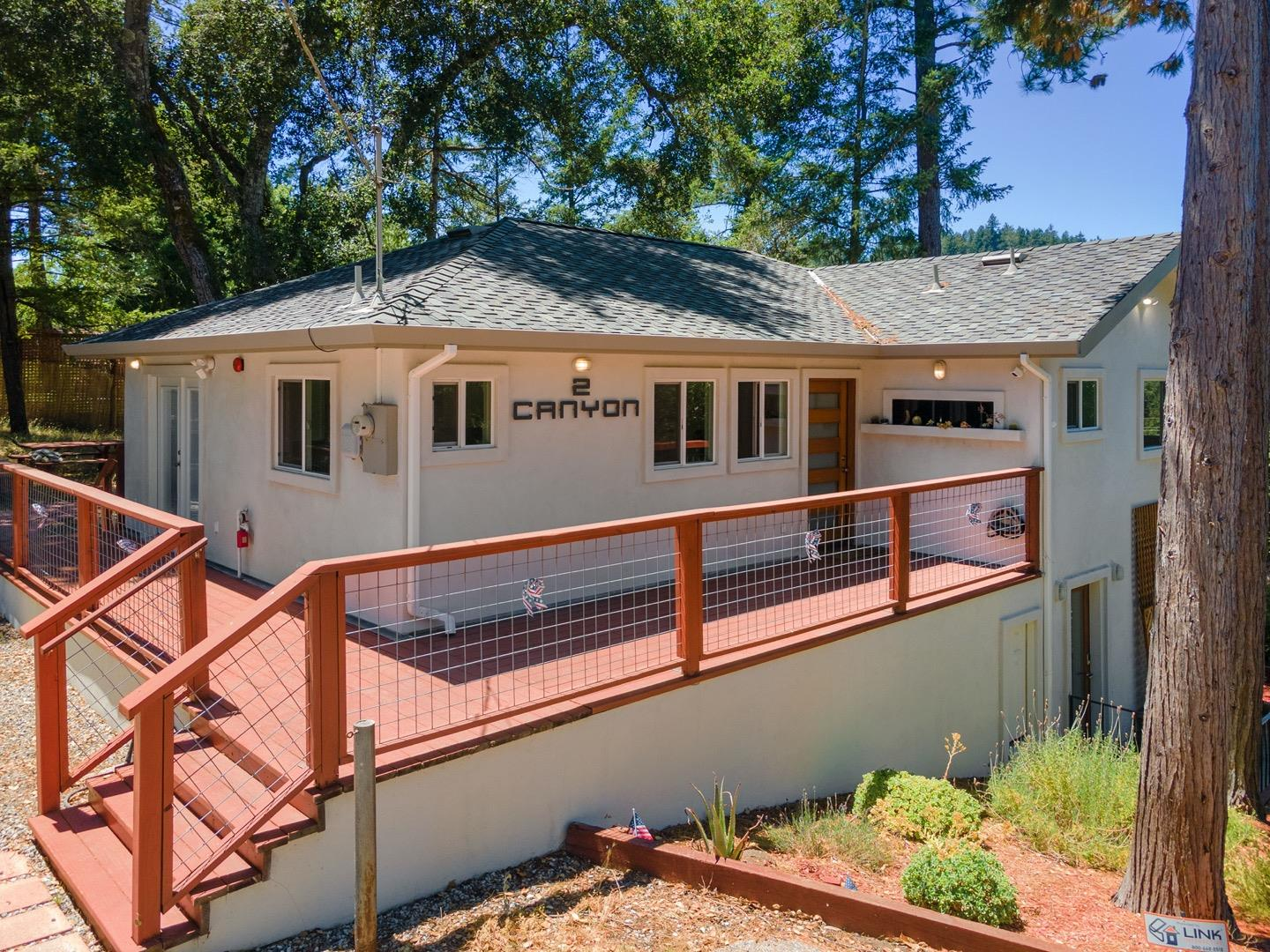 Beautiful contemporary 4 bedroom/ 3 bathroom home in the Mt Hermon Community. Great central location between the towns of Scotts Valley and Felton. Average driving time to Felton is 2 min, 3 min to Scotts Valley, and just over 10 min to Santa Cruz making this a great commuter location. The home underwent a major remodel in the second half of 2016 which included updating the bedrooms, bathrooms, and kitchen, as well as a new roof, foundation repairs, new fire sprinklers, and a new engineered septic system.  Outside there is a good mix of sun and shade with sunny deck. If you have dogs or want to own chickens, there is a dog run to keep them safe and secure. For those seeking adventure you can access hiking and biking trails just down the road. For a small fee, you can gain access to the Mount Hermon amenities which includes a community swimming pool and adventure center. This safe neighborhood doesn't have a traditional HOA, but has a water and road agreement.