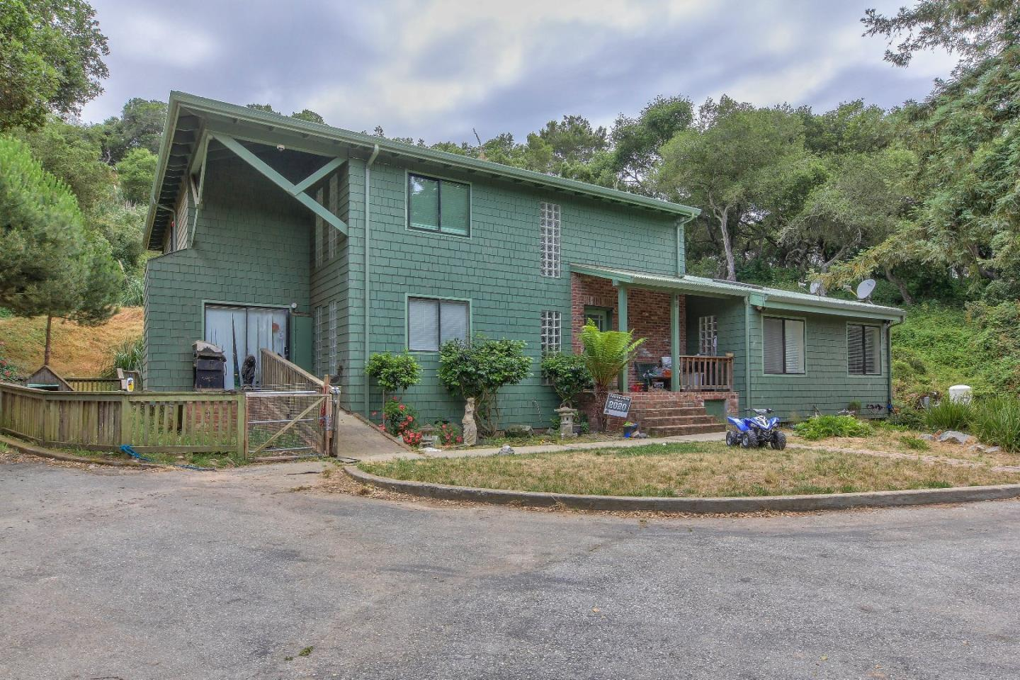 Beautiful property near Elkhorn Slough; almost 15 acres, fenced, large shop or barn home almost new 2 wells and separate driveway to barn and stables......many possibilities!