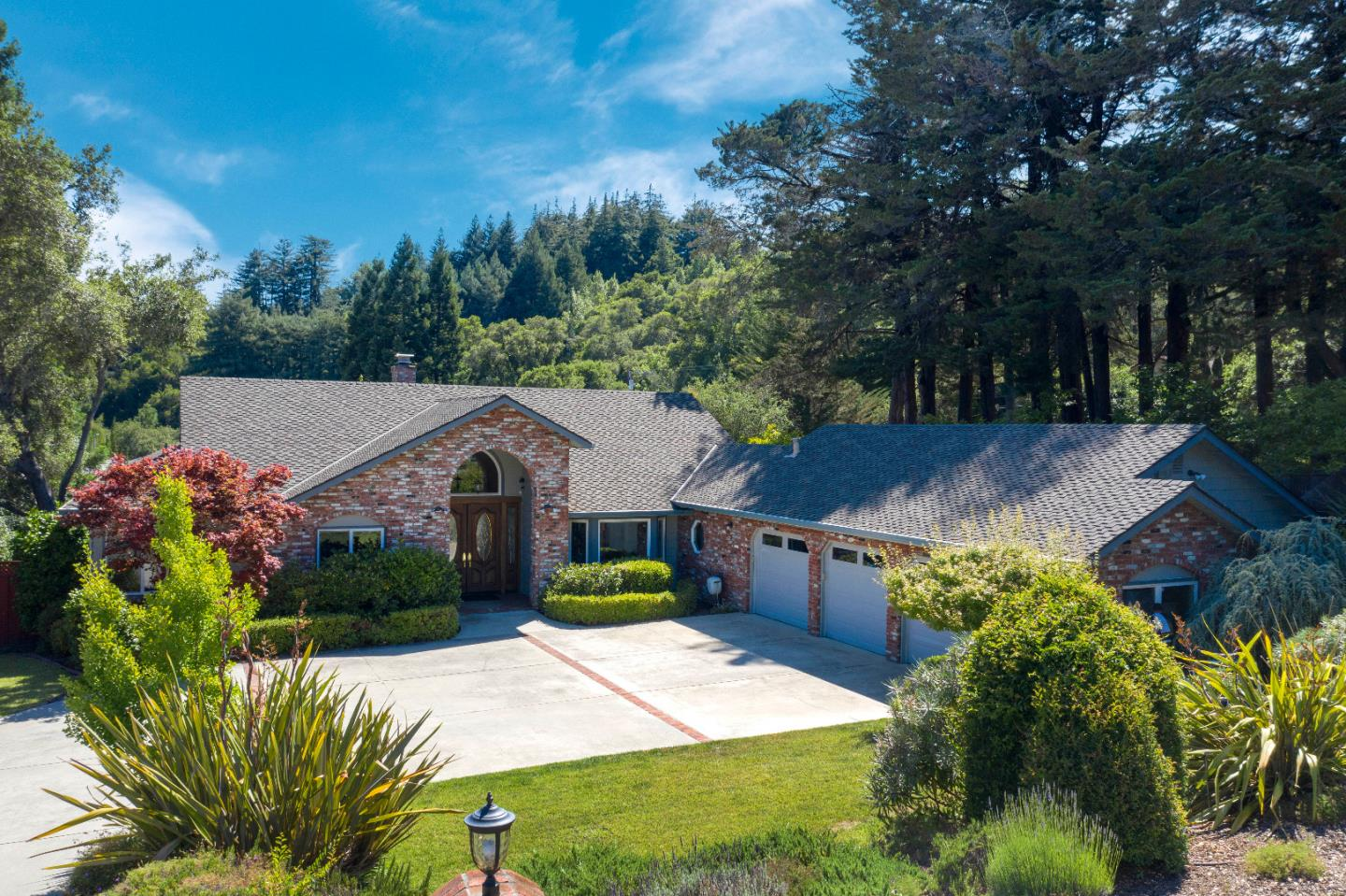 Superbly appointed single level 4 bedroom home in Granite Creek Estates.  This is an impressive property.  Indoor amenities include a Chef's kitchen, wine cellar, hardwood floors with custom inlay detailing, 3 fireplaces, high ceilings, a 3 car garage and abundant storage.  There is a fireplace in the living room, family room and master bedroom.  The floor plan is extremely well designed.  Outdoor amenities include a bocce ball court, custom luxurious fire pit, decks for entertaining, and manicured mature gardens . Easy commute access to Santa Cruz and Silicon Valley.  Top rated Scotts Valley Schools.