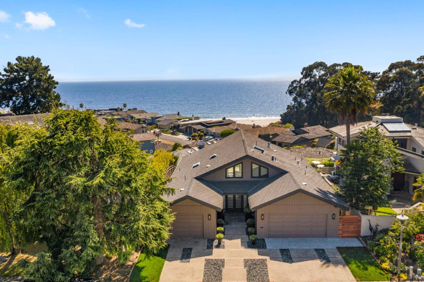 This amazing ocean view home is near remodel completion and located in the sought after neighborhood above Rio Del Mar beach. The ocean view begins when you walk through the double-door entry and into the open concept living space. Folding glass doors take you onto the extensive new deck. Master Bedroom is on the lower level with his & hers bathrooms, his & hers walk-in closets and a fireplace to warm those cool winter evenings.