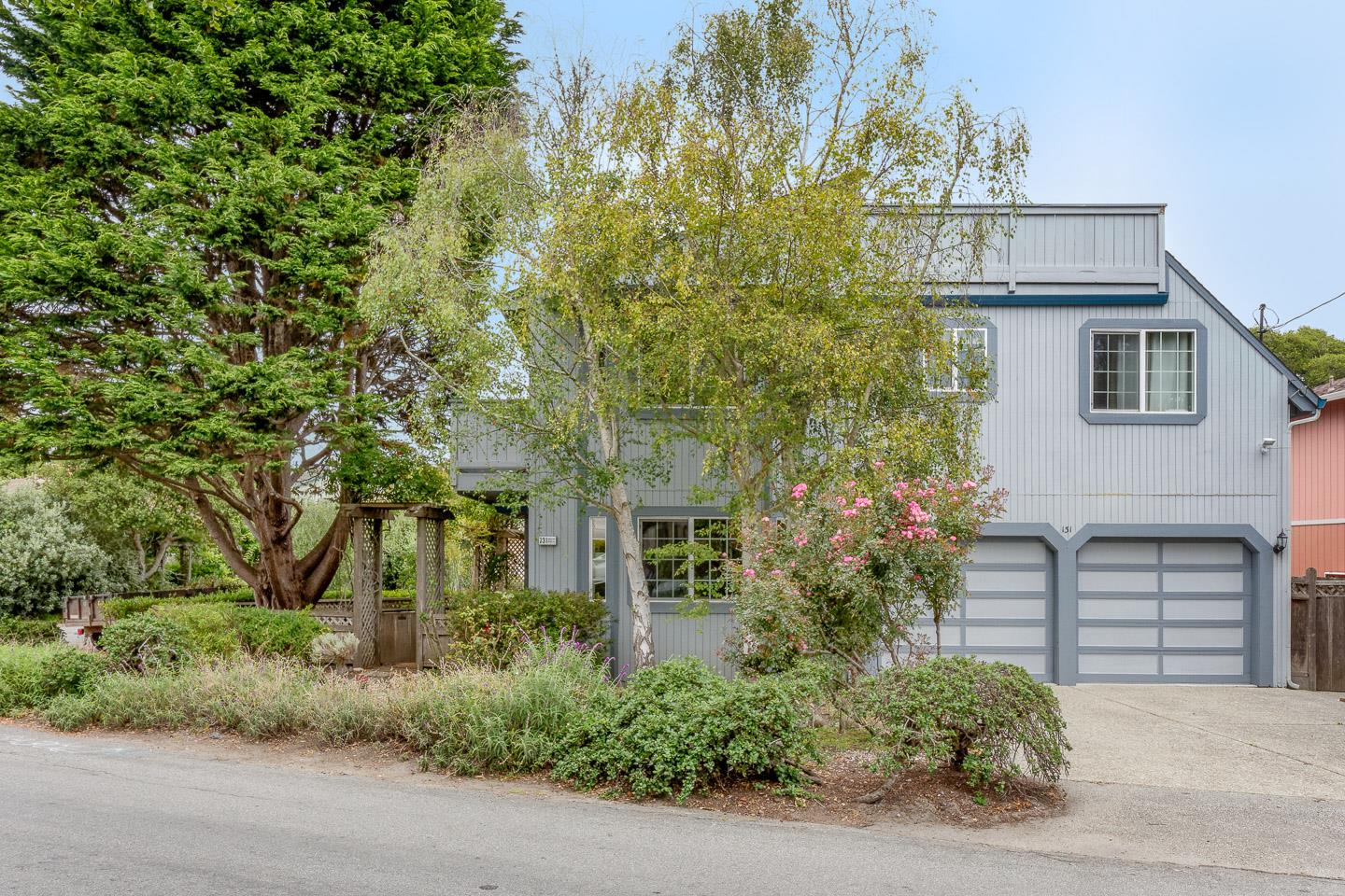 Situated in a fabulous Seacliff neighborhood, this custom designed home offers a light & bright interior featuring hardwood floors, abundant windows & skylights, eat-in kitchen w/corian counters, ample cabinet & counter space, large pantry, breakfast bar, plus dining room. The living room has vaulted ceilings, skylights & Vermont Castings wood stove. The master suite features a vaulted ceiling w/clerestory windows, a large walk-in closet & private deck. The downstairs bedroom has French doors to the backyard. Laundry room has a full bathroom & new custom tile shower & floor. Home gym in garage. There is a patio, fenced backyard & a rooftop deck w/a peek of the bay & surrounding hills. The home is located on a quiet street walking distance to Seacliff Village & the expansive sands of Seacliff State Beach. Recent upgrades include some new light fixtures, light switches, faucets, toilets & showerheads. Good separation of space to work from home.