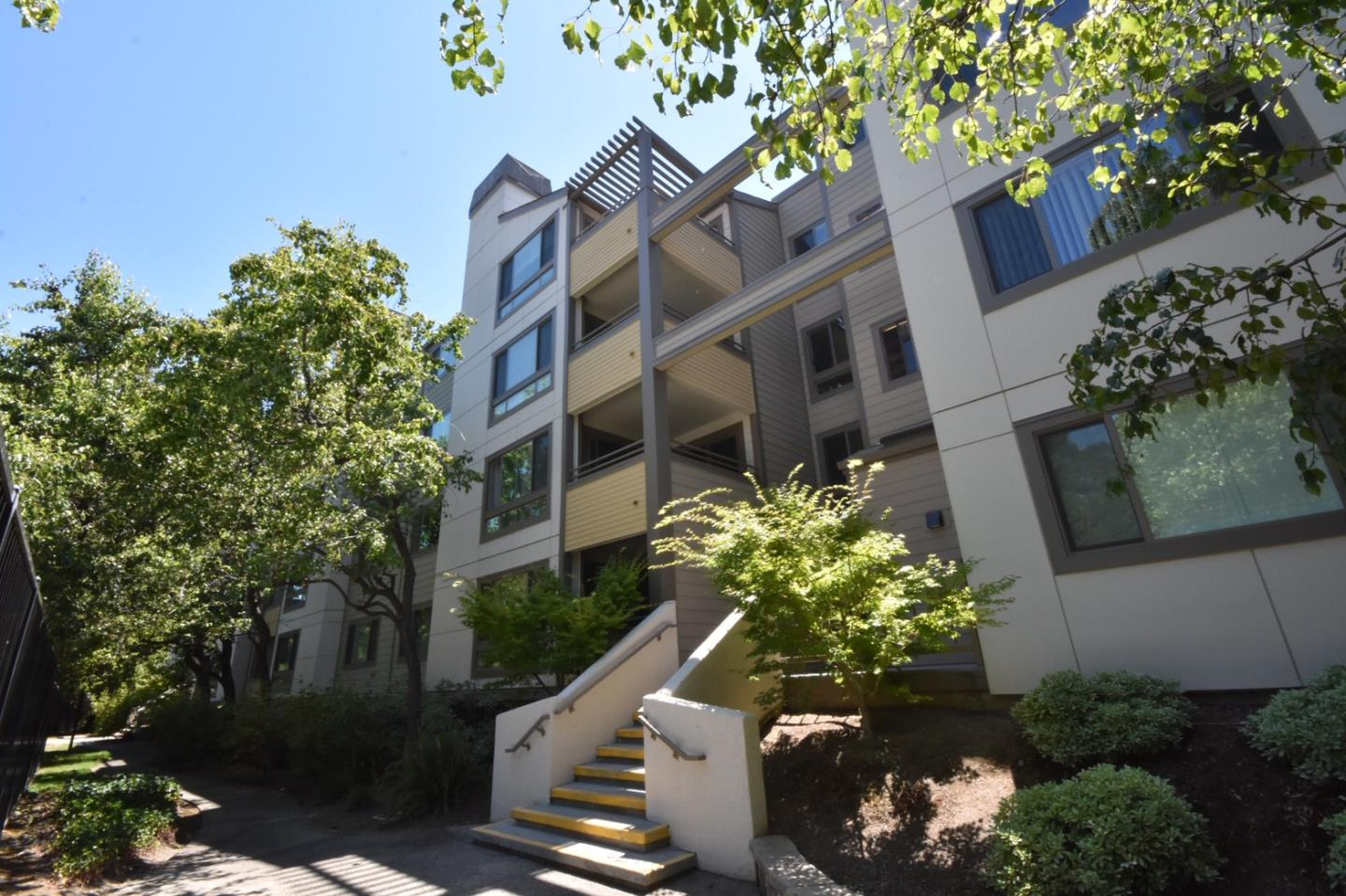 Welcome to this quiet top-floor condominium home with beautiful golf course and pool views,soaring ceilings and lots of natural light. you can enjoy two private master suites, a modern kitchen with new stainless appliances and quartz counter tops, new carpeting, paint, lighting and much more. North-west facing unit stays cooler in summertime and let you enjoy your outdoor balcony area and sunset views. Oversized living room with cozy fireplace and large windows/glass door overlooking the tree tops. Inside washer/dryer. Gated underground parking with elevator, extra storagespace/bike locker, refurbished pool & spa, childrens playground, community room with kitchen, and additional parking is all included in the HOA fee. Plenty of off-street parking and conveniently located near 280, 101, El Camino Real, and Lawrence Expressway, right in the heart of Silicon Valleys tech center. Best location in complex!