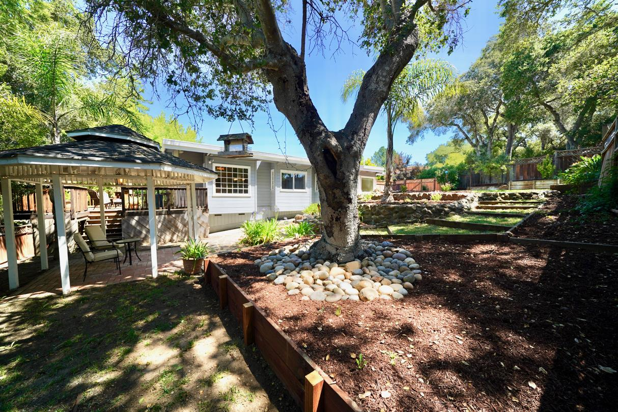 OH. MY. GOODNESS. Absolutely BEAUTIFUL home in desirable Scotts Valley neighborhood on a large and private lot! Walk in to a stunning and open floorplan that flows and features a tremendous amount of natural light everywhere! Beautiful wood flooring and wood beam ceilings will sooth your soul as you walk through this home and settle in the living room next to a stunning river rock fireplace that looks like it was taken out of the Ritz Carlton in Tahoe. Views of SV mountains fill the living room windows. The kitchen is gorgeous with corian counters over stunning cabinets, a large kitchen island, stainless steel appliances and incredible wood beam ceilings. Adjacent is a separate family room with views to the inviting and private back yard and access to the large and private wrap around decking. The large master bedroom with vaulted wood beam ceilings and skylights (ok, I'm bragging now) also has a walk-in closet and a stunningly upgraded master bath. ALL baths are upgraded!