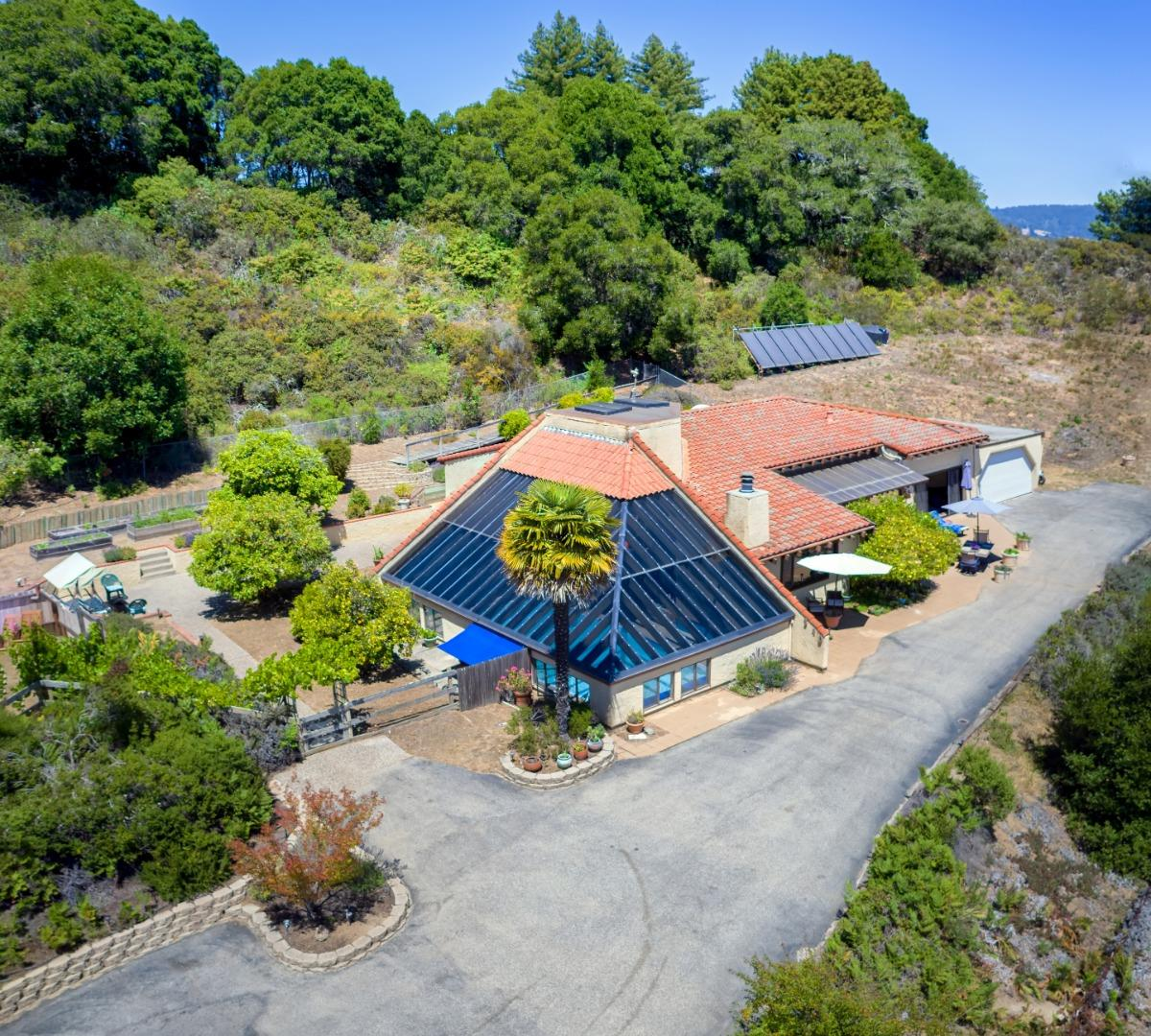 With spectacular sweeping views of the Monterey Bay & Pajaro Valley, this 4 BR single level home is nestled on 5 usable acres. Amenities of this well built home include a custom hand carved entry door, built-in cabinetry, vaulted beam ceilings, a rock fireplace & an indoor pool to enjoy year round swimming! Separately metered two story 1200 s.f. barn (perfect home office, studio, or possible ADU), large fenced back yard, terraced landscape with multiple areas to enjoy the expansive views, a detached sauna, & plenty of room to garden with great southern exposure. PG&E gas service, city water, nest thermostats & high speed internet. Many fruit trees on site, including avocado and citrus. This serene retreat is located at the end of a private drive, yet only minutes to beaches, shopping, dining & Hwy 1. You're sure to appreciate the microclimate & Corralitos community, with its famed market & wine trail. Gazing out over the ever changing views, you simply cannot help but relax & unwind.