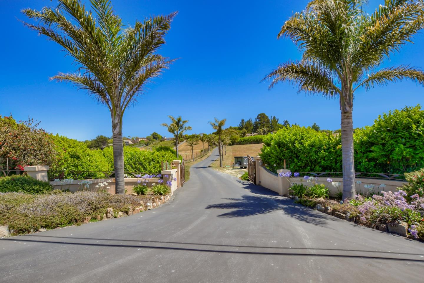 Stunning ocean view Mediterranean on 2.5 plus sunny, gated acres.   When you enter the property from a quiet country lane that borders nearby Manresa Beach state park you are immediately in touch with the natural environment and the views of the surrounding countryside and Monterey Bay beyond.  The custom home was originally built by the contractor-owner as his own residence and has many custom features including radiant heat, exterior stucco and tile roof with copper gutters and downspouts. The home features an open kitchen-living area, two Master suites, one with ocean view, private ocean view patios and large three car garage.   Zoned for a large second guest unit and perfect for small vineyard/or?   Beautiful as is and even more upside potential.  Great opportunity!