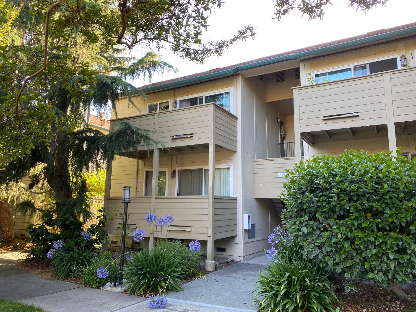 "Best location in the complex away from the street! This stunning upstairs end unit has been completely enhanced and upgraded including handsome wood color laminate floors, dual pane ""Milgard"" windows including sliding door. Lots of natural light throughout. Spacious living room dining room w/sliding door to private balcony overlooking the garden and the pool. Large bedrooms w/closet organizers. Granite counters in kitchen & bath. Crown moldings. Ceiling fan in dining room & master bedroom. Kitchen features Shaker cabinets, stainless steel refrigerator, stove, micro & dishwasher. Indoor laundry, washer & dryer included. Remodeled bathroom. Added insulation in bedroom walls. A/C unit in dining room. Carport. Xtra storage unit. Community amenities include playground, swimming pool & BBQ area. Quiet location yet just minutes away from stores, major freeways, light train & high tech companies Apple (4.6m), Google (5.5m), Facebook, Amazon, Microsoft and more. Short walk to large park & shops"