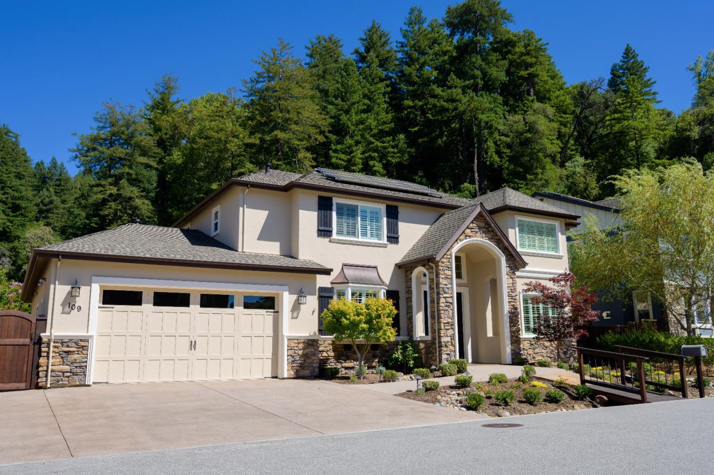 ABSOLUTELY SPECTACULAR EXECUTIVE HOME IN GATED COMMUNITY in beautiful SCOTTS VALLEY! This home is absolutely LOADED with so many incredible features including SOLAR and an incredible spacious lot that features an outdoor kitchen, pavilion, fire-pit and lots of grass for the kids and pets! It also backs up to the hills with acres and acres or hiking trails and all the beauty that this community offers. Inside you will walk in to a beautiful double-door entry, high ceilings and wood flooring throughout the downstairs area. Lots of beautiful double-pane windows that bring the outside in everywhere! OH MY GOODNESS.. What an INCREDIBLE KITCHEN! Lots of granite counter-tops over beautiful wood cabinets, stainless steel appliances and a large center island. Just a DREAM! Separate family room and living room each have their own beautiful fireplaces. The master bedroom suite is spectacular with large walk-in closet and a bathroom that just WOW's you! Large bonus room downstairs can be 5th bdrm.