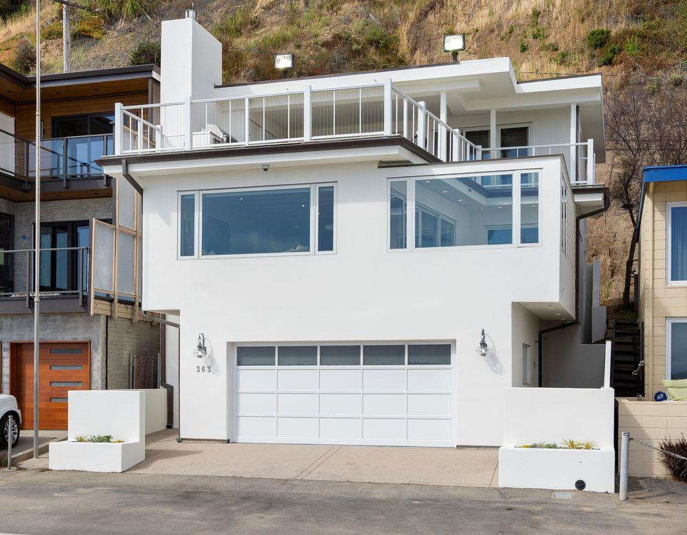"""Fun in the Sun! Come SEA the Jewel of Beach Drive. This stunning oceanfront property is the very definition of California coastal living. Head to toe renovation in 2010 with only the finest materials and craftsmanship. Features 4 bedrooms and 3.5 baths with two private en-suites. Expansive upper sun deck with built in BBQ & refrigerator. Enclosed """"glass wall"""" lower deck off main living area. Appointments include: Viking and Bosch kitchen appliances, bamboo flooring, integrated whole house sound system, custom hi-tech lighting and artisan tile finishings. Enjoy unobstructed panoramic ocean views from Monterey to Pleasure Point. This home has been meticulously maintained and is ready for your summertime fun:)"""