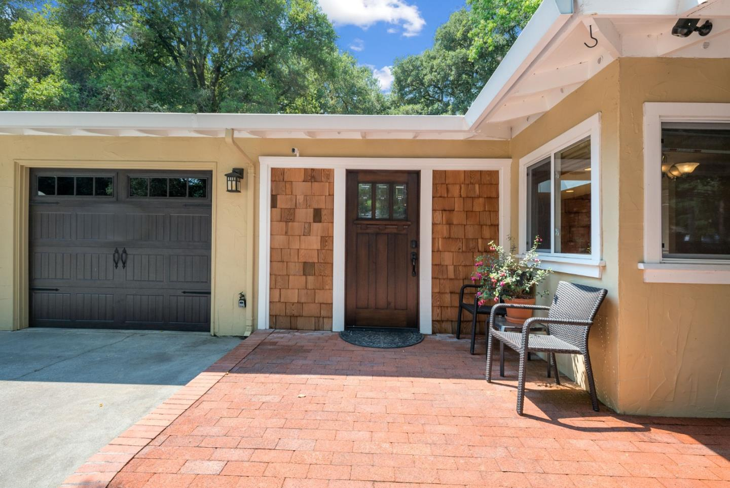Stylish turn-key home located in one of Scotts Valley's most desired neighborhoods. The home is 3BR/2BA, 2300+ sqft, single level with wheel chair friendly hallways, attached 2 car gar w/ a huge fenced backyard. Kitchen is bright & open w/ ample counter & cabinet space, cooking island, breakfast nook, and open to area that could be a formal dining room or a family room. Oversized living room accessible from the hallway and the kitchen, features a wood burning fireplace, stone accent wall, and French doors to the backyard patio. Built-in speaker system throughout the house & yard. Flat & usable .38 ac lot w/ sunny space to garden, native oak trees provide shade, grassy areas to play, and plenty of parking for all your toys. Detached shed/bonus room w/ potential as an art studio, workshop. Great neighborhood in a top school district, within walking distance to Scotts Valley shopping and dining & Henry Cowell hiking trails. Easy freeway access for commuting or beach-going.