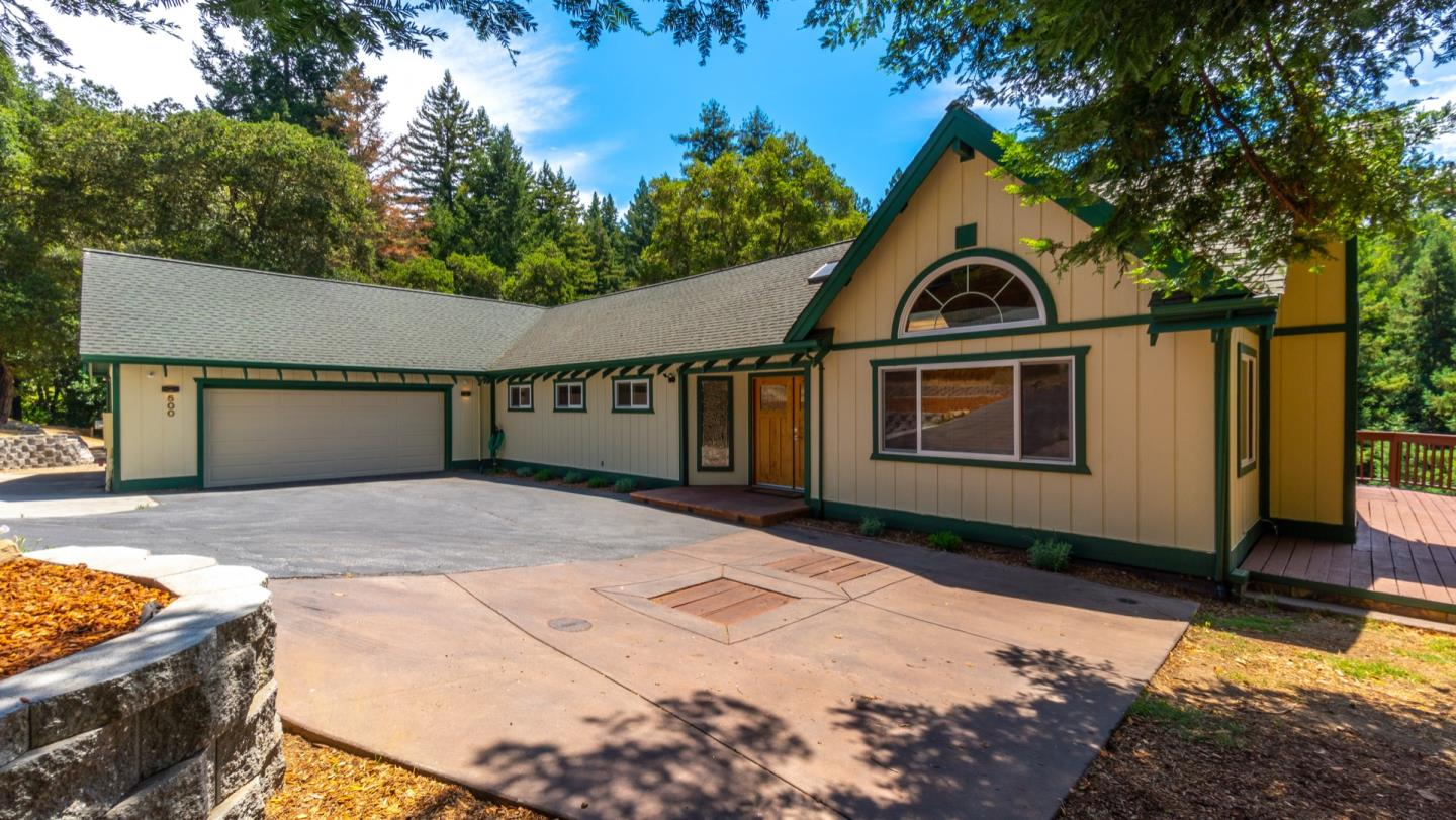 Fabulous single level home on almost 6 acres with Virgin Redwood Tree in the front yard! Located in Nina Terrace, minutes to downtown Boulder Creek. Renovated in 2018: Arizona flagstone entry steps to an elegant beveled glass, double front door with an Arlo surveillance doorbell that leads into the wonderful open floor plan, vaulted ceilings, Tuscany pattern Travertine floor & Knotty Alder doors & trim throughout. Living room hearth has an efficient Regency wood stove, newer Milgard windows & sliding glass doors look out onto the mountains and the forested acres behind the house. The kitchen is a chef's dream featuring cherry soft close cabinets with under cabinet lighting, granite counters, a professional Bertozzoni Range Oven & a wine fridge. Exquisitely designed baths & bedrooms with illuminated closets & built-ins in master closet. Large sunny yard with many garden areas. Stone walls maximize space for orchard or RV parking. 30 mins to Silicon Valley or the beach!