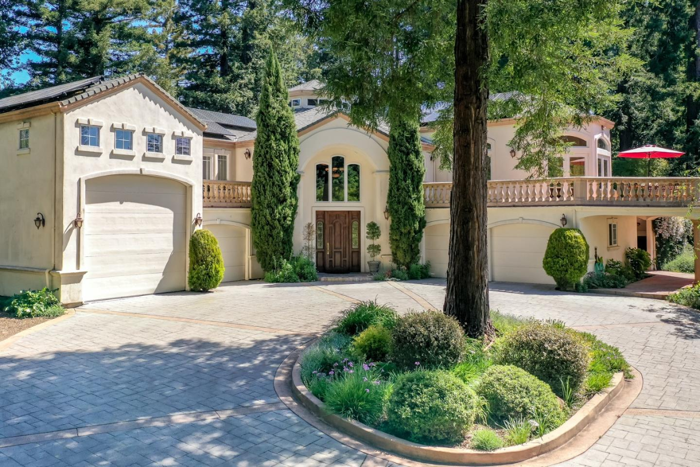 "This gated Country estate 14 miles above Silicon Valley, via Highway 9, provides a front row seat to mother nature with sweeping ocean & forest views, resort like living, fresh mountain air and complete privacy.  Offering direct access to ""Skyline to Sea Trail"" & 30K acres of state parks, the property also boasts stands of cathedral redwoods surrounding a 5 bd/3.5 bath main residence, a 632-sf Guest House, 664-sf gym, saltwater pool, spa, 1/1 sunlit cottage, 5-stall barn with outdoor arena and miles of riding trails perfect for any outdoor enthusiast.  The Great Room showcases vaulted ceilings surrounded by french doors to a veranda with views of Monterey Bay adjacent to the chef's kitchen, large dining area, & luxe master suite with spa-like bath, fireplace, & private deck. The home features a large office to work from home, plus a media room, billiards & library to provide entertainment. The property generously hosts everything from family BBQs to large-scale galas."