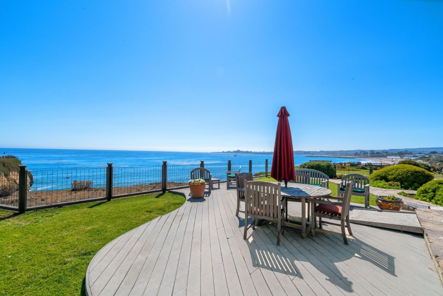 One of the best oceanfront locations in Santa Cruz with direct views of the Yacht Harbor, West Cliff Drive & the Boardwalk. Located in a private gated enclave next to Black Pt nestled between Twin Lakes Beach & Sunny Cove with quick beach access. One of the few premier locations along the Santa Cruz coastline w/almost 1/2 AC flat bluff top lot on a cul de sac. Incredible ocean views out almost every window. The single-level cottage has 2BRs w/hardwood floors, gas fireplace in dining/living area, cozy office nook, updated baths & kitchen. There is also a separate 2BR guest suite, 1 car garage & a large parking area. Plenty of room for entertaining w/multiple patios, decks, & lawn w/built-in BBQ & hot tub. One of the few original homes left on the street. A wonderful place to watch spellbinding ocean sunsets, sea life, entertain & unwind. You may never want to leave home, but if you do, you are a short distance to restaurants & activities at the Yacht Harbor & the popular Pleasure Point.